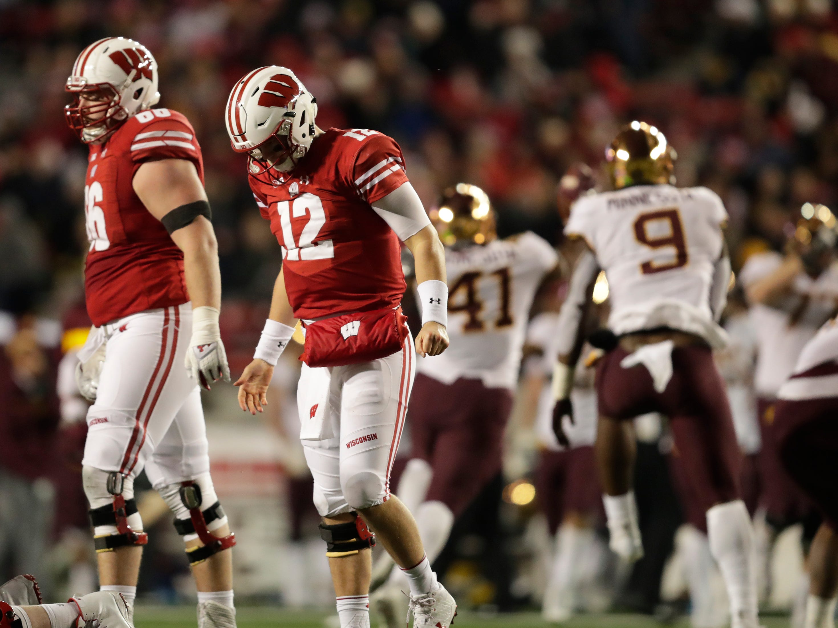 Wisconsin quarterback Alex Hornibrook hangs his head after losing a fumble against Minnesota in the fourth quarter on Saturday.
