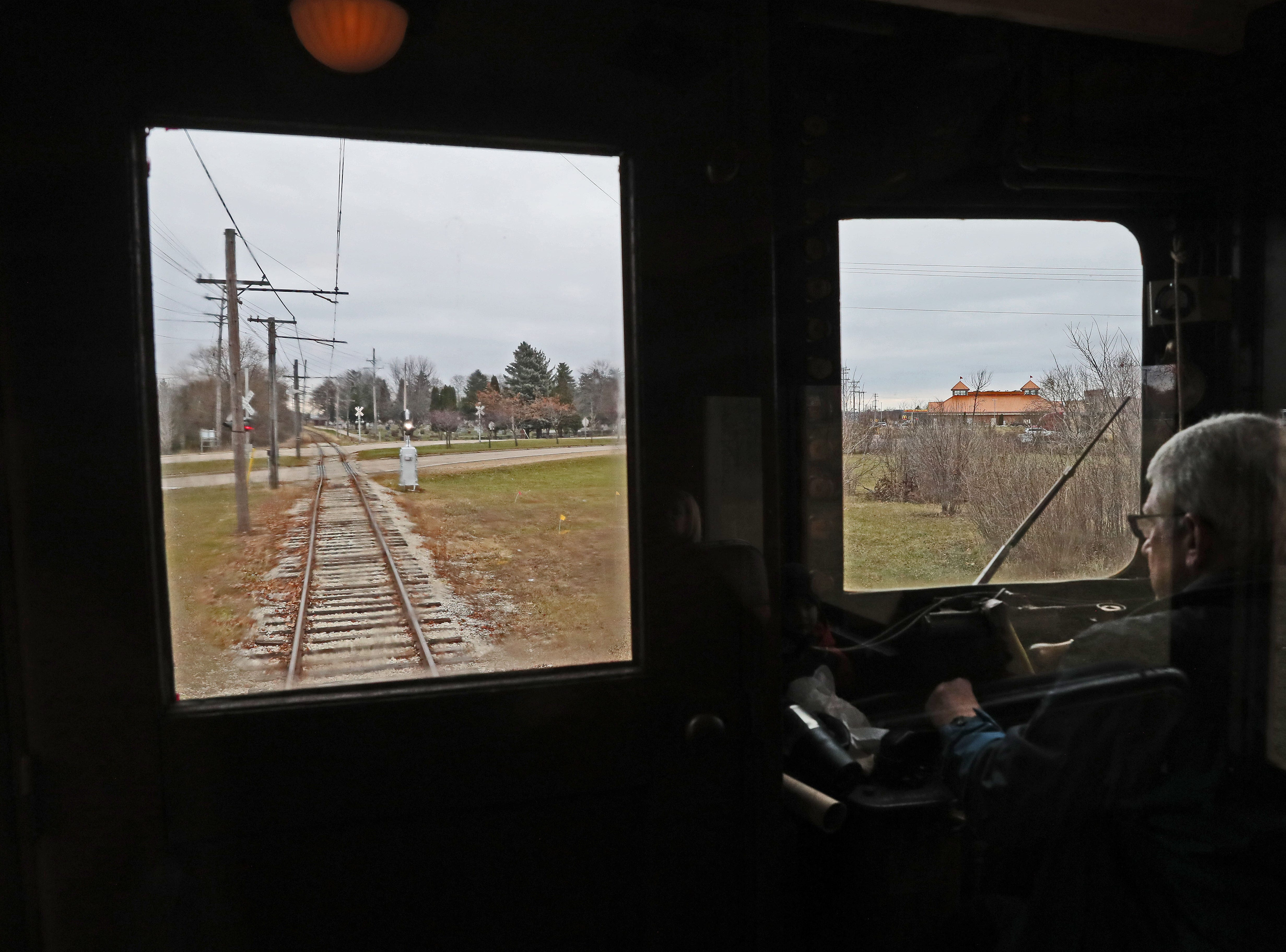 Enclosed in his own compartment, Bob Ryan, the motorman, is at the controls of the train on its leisurely trip to Mukwonago.