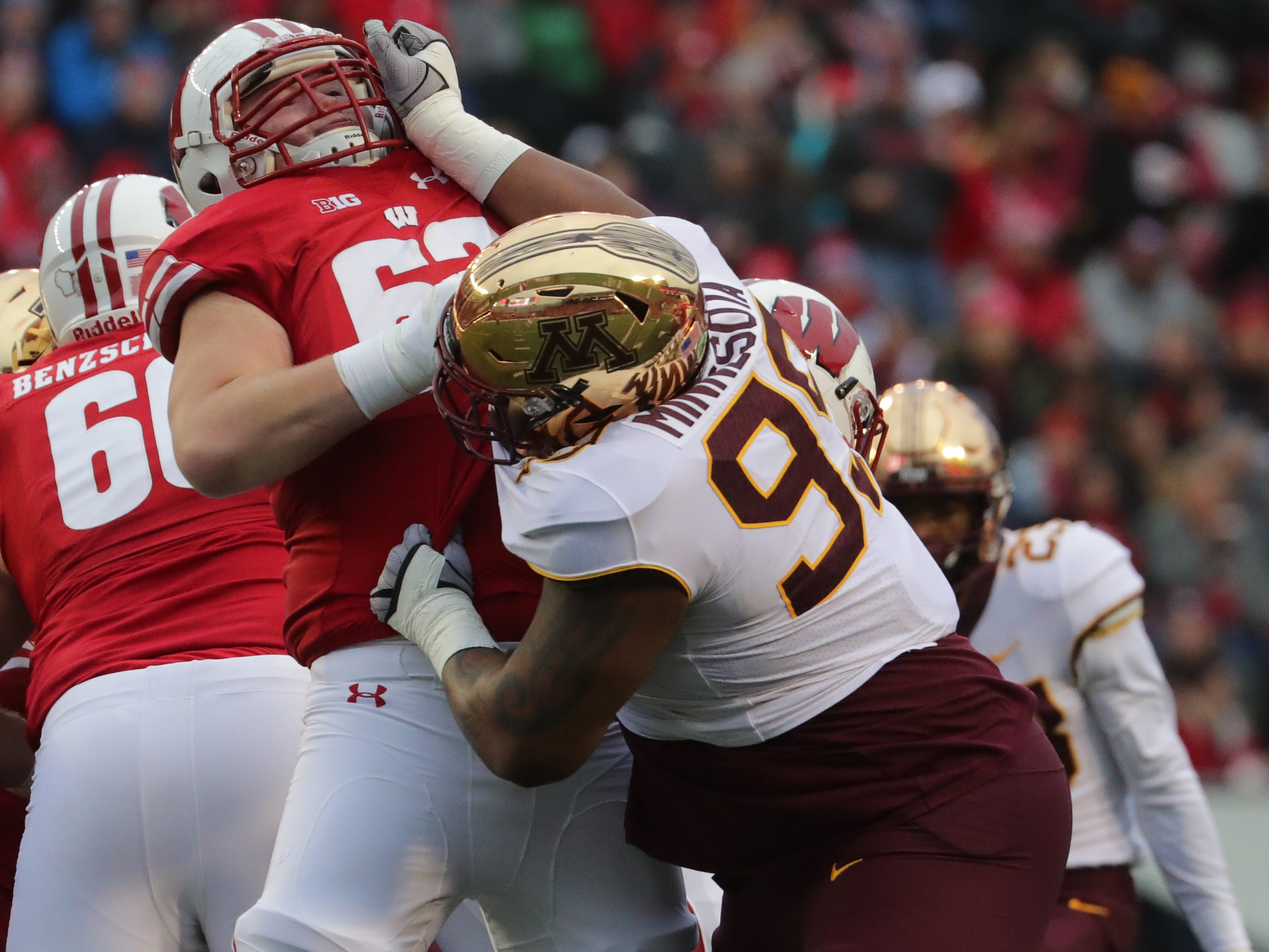 Wisconsin offensive lineman Michael Deiter duels with Minnesota defensive lineman O.J. Smith during the second quarter Saturday.