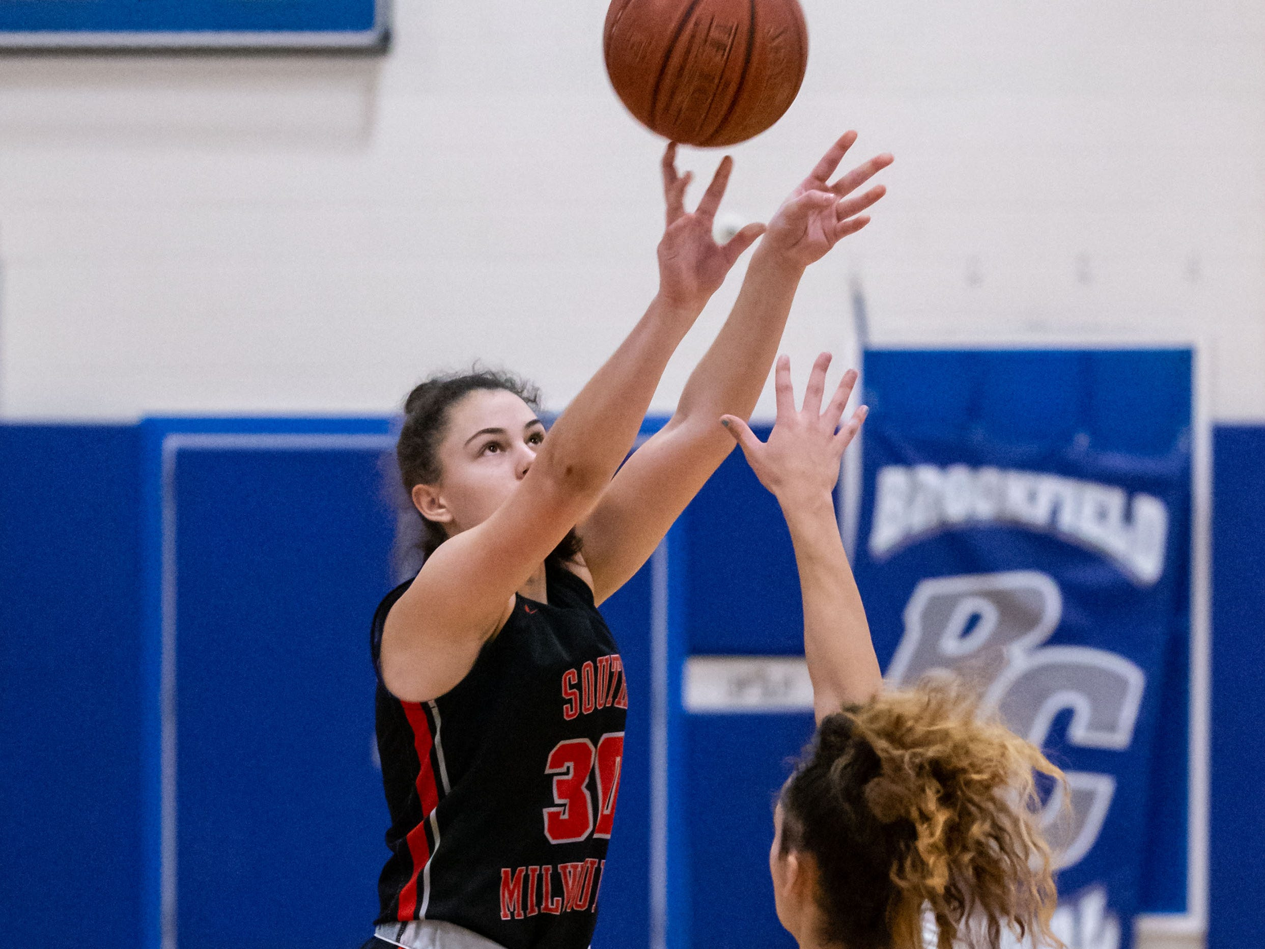 South Milwaukee junior Kayla Tierney goes up for three during the game against West Allis Hale at the Brookfield Central Thanksgiving Shootout on Saturday, Nov. 24, 2018.
