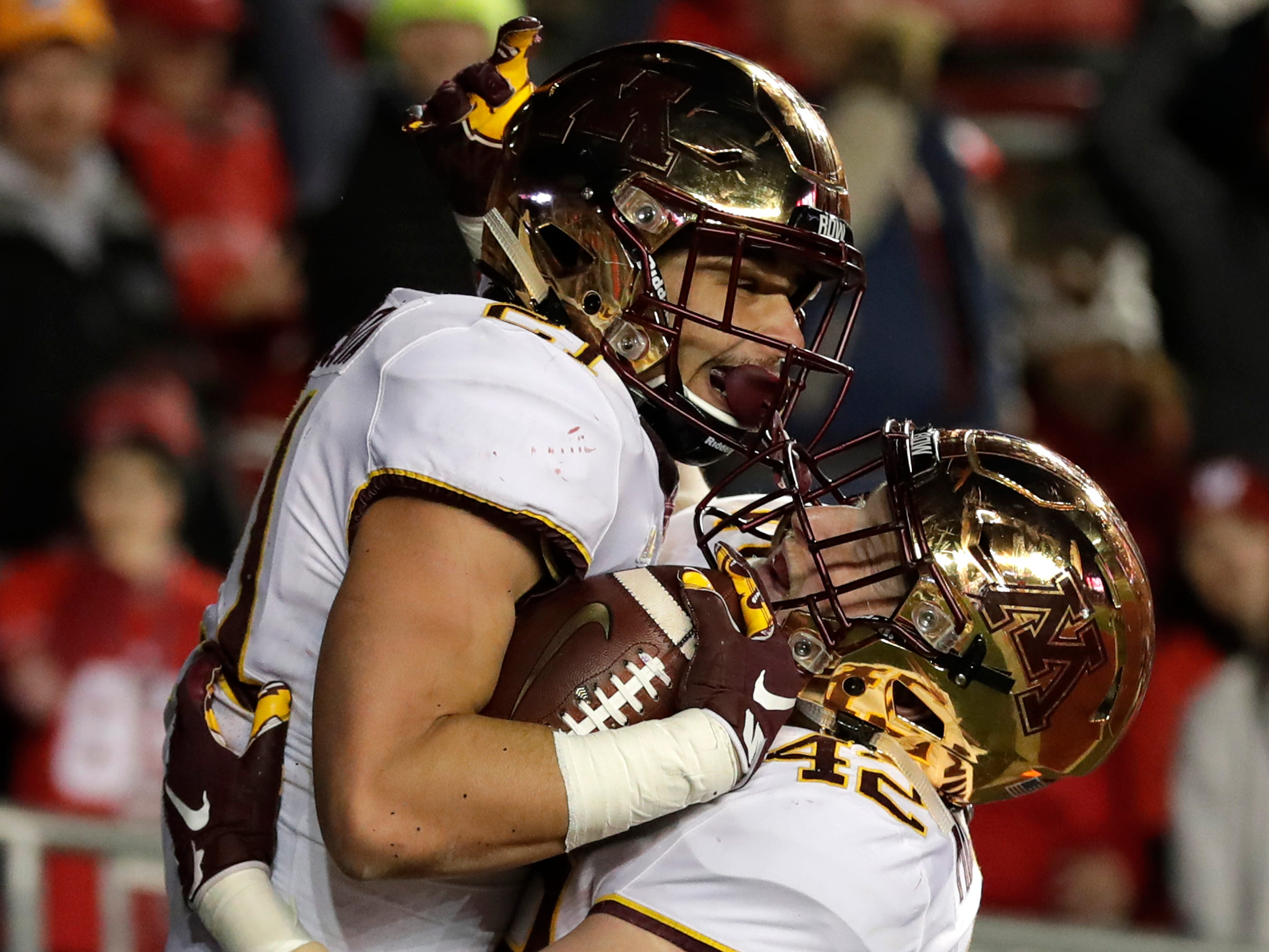 Minnesota running back Bryce Williams (left) celebrates one his two touchdowns in the fourth quarter against the Badgers with teammate Ko Kieft on Saturday, November 24, 2018, at Camp Randall Stadium in Madison, Wis.