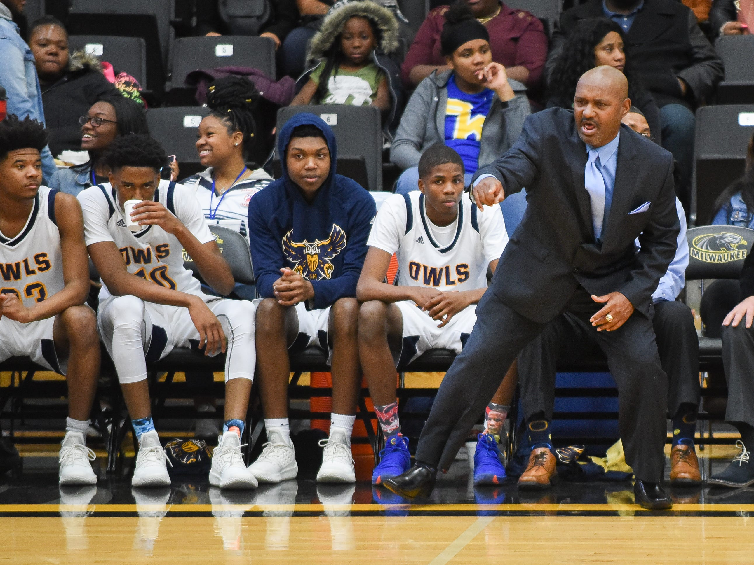 Golda Meir coach Charles Jordan shouts instructions to his team as it plays West Allis Central in the Fresh Coast Classic basketball showcase Saturday, November 24, 2018, at UW-Milwaukee's Klotsche Center.