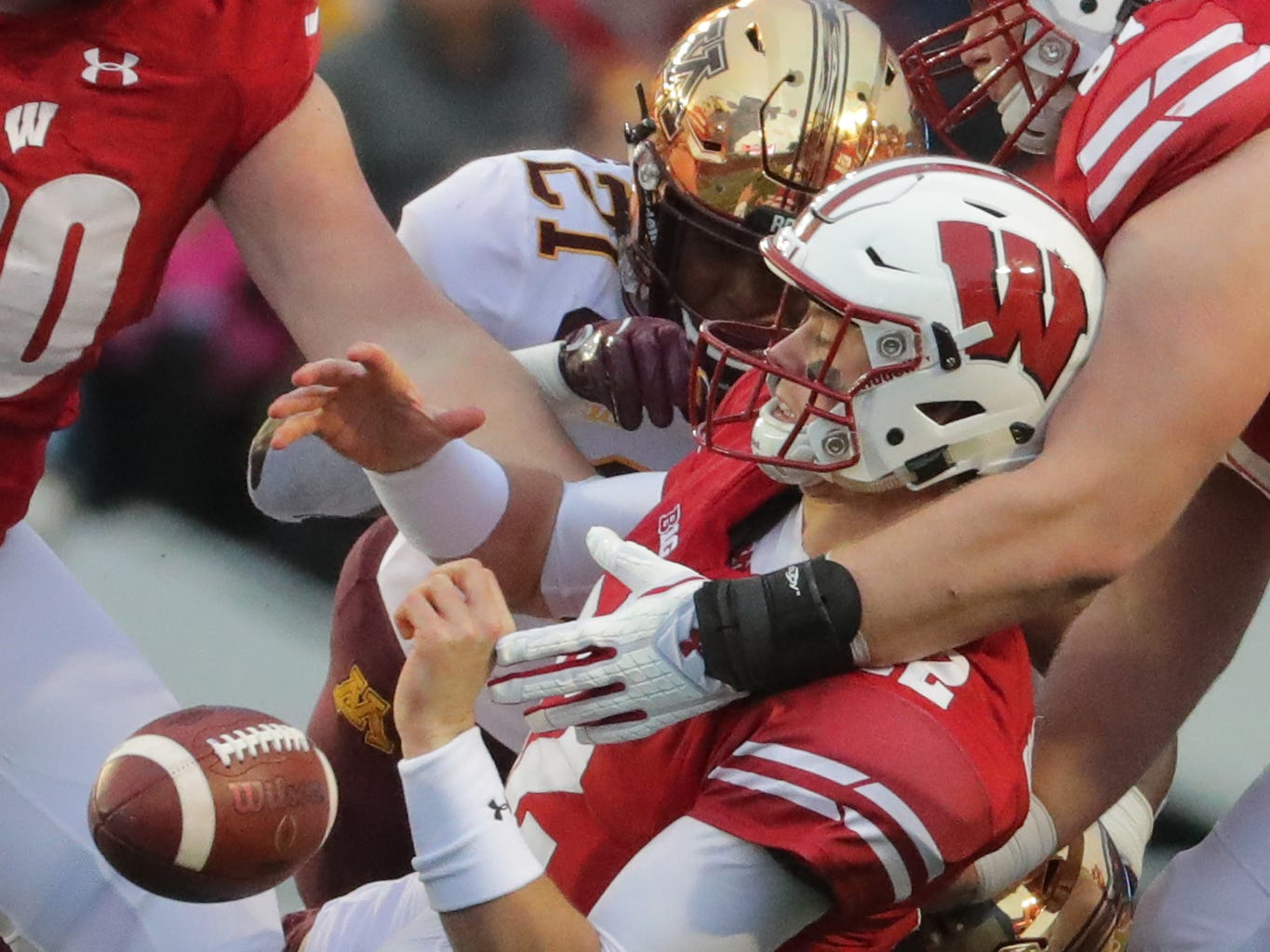 Wisconsin quarterback Alex Hornibrook fumbles while being sacked by the Golden Gophers defense in the second quarter Saturday at Camp Randall Stadium in Madison.