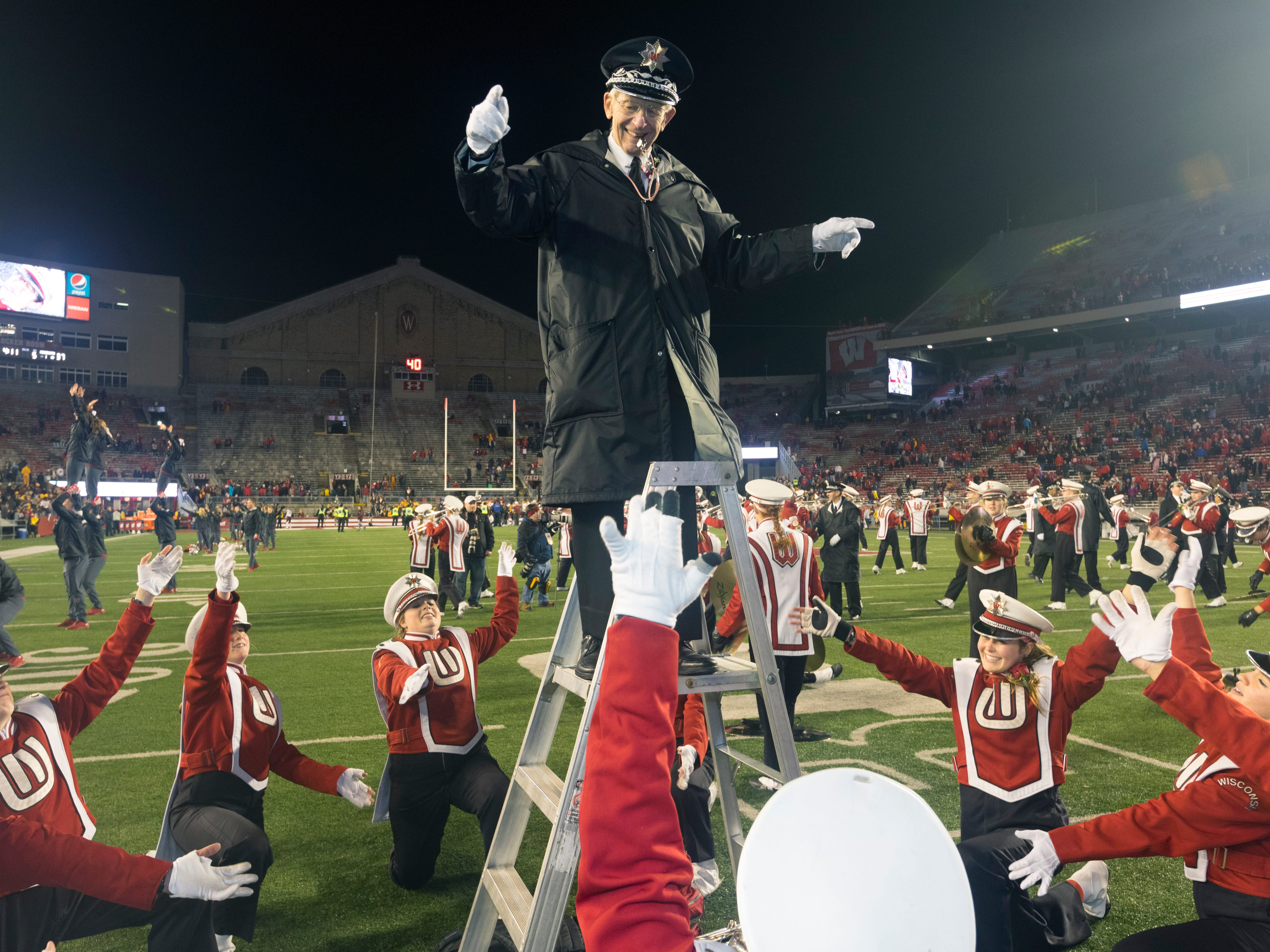 """Retiring Wisconsin band director Michael Leckrone enjoys his final """"Fifth Quarter"""" show on Saturday at Camp Randall Stadium."""