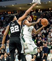 Bucks guard Sterling Brown takes a shot against Spurs forward Rudy Gay in the fourth quarter at Fiserv Forum on Saturday night.