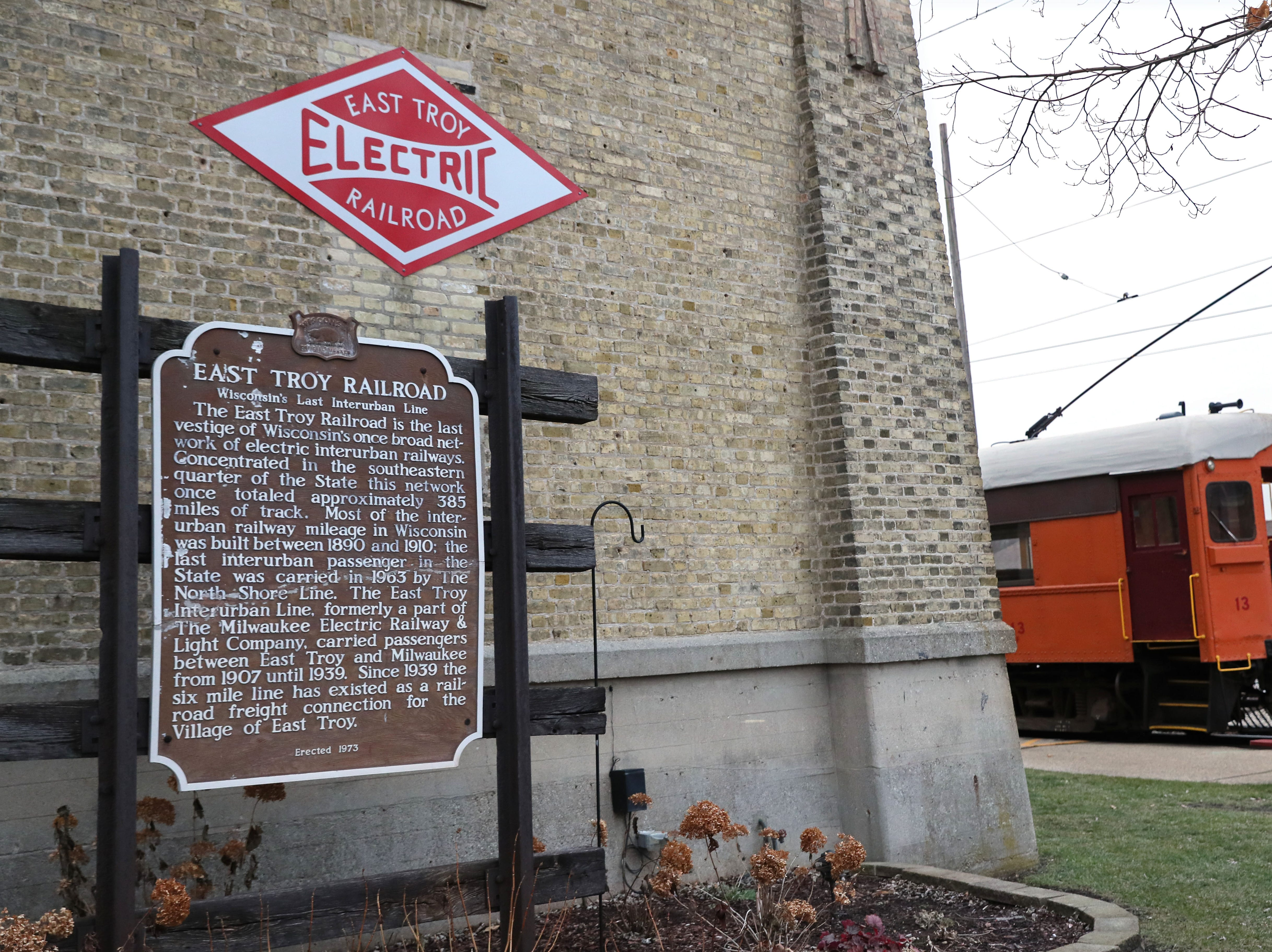 A historical marker stands in front of the depot in East Troy.