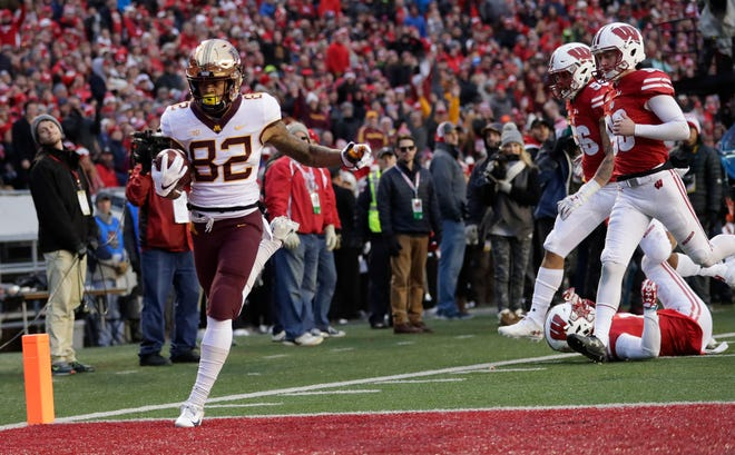 Demetrius Douglas Douglas leaves members of the Badgers' punt coverage unit in his wake as he crosses the goal line on his 69-yard punt return in the second quarter on Saturday.