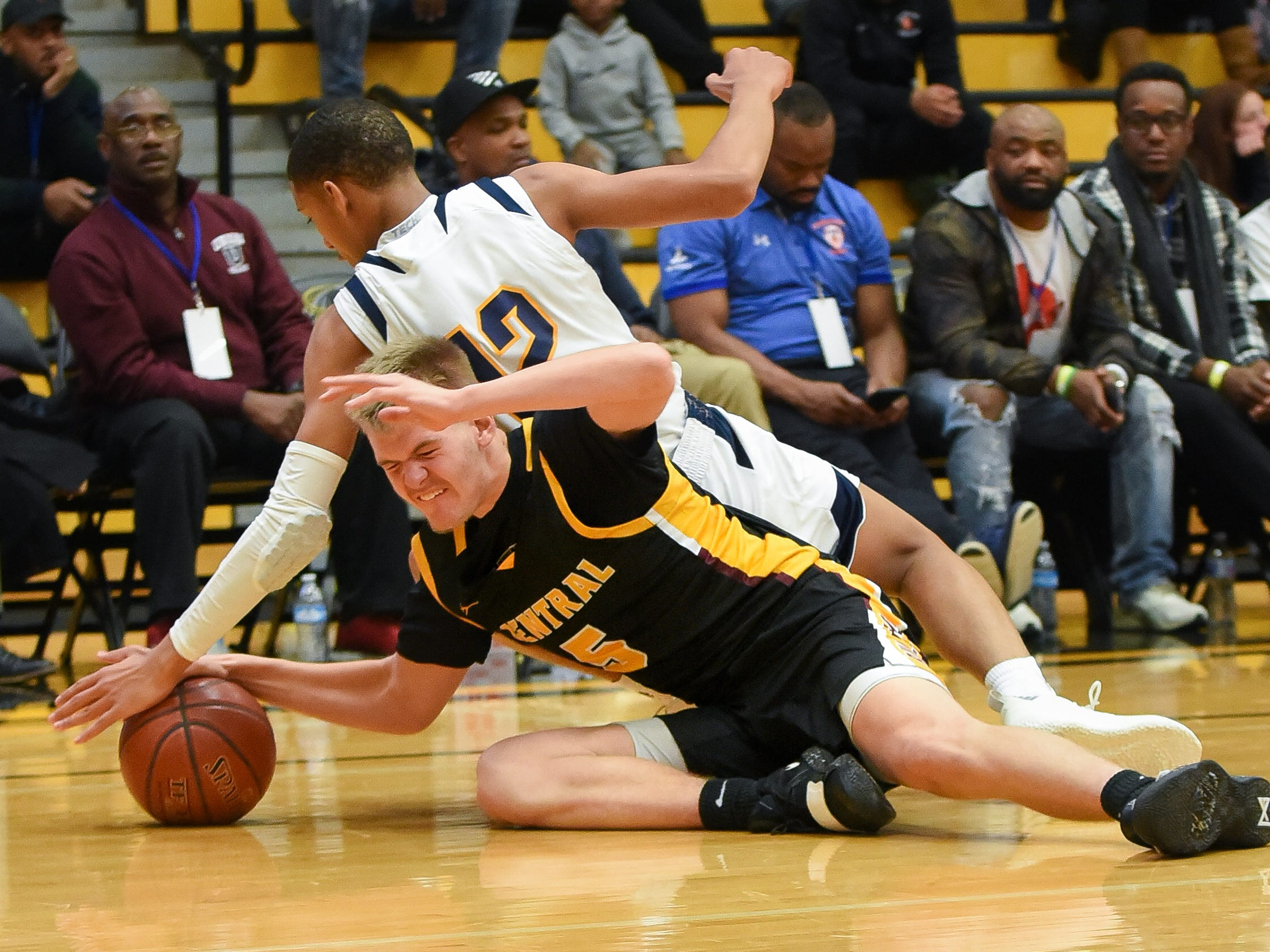 West Allis Central senior guard Cameron Drury (bottom) and Golda Meir senior guard Kai Parham hit the floor for a loose ball in the Fresh Coast Classic basketball showcase Saturday, November 24, 2018, at UW-Milwaukee's Klotsche Center.