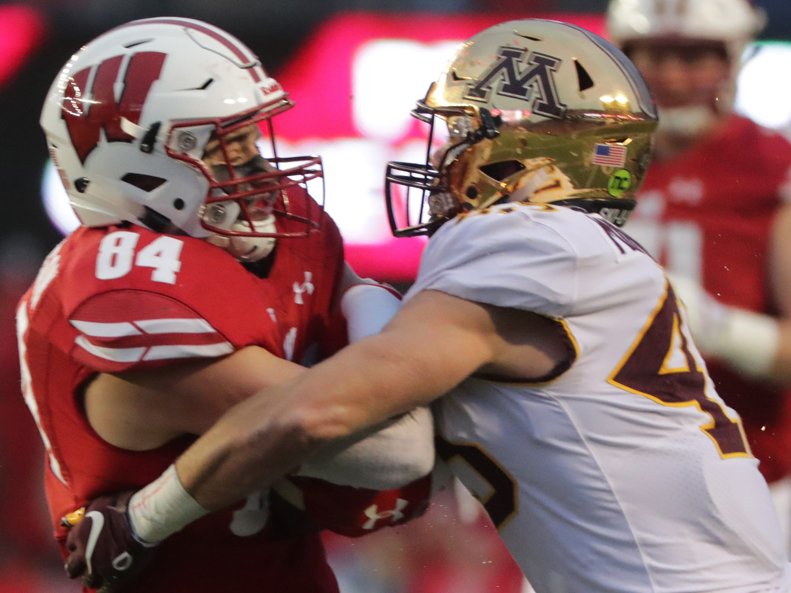 Wisconsin tight end Jake Ferguson is able to hang onto a reception that produced a first down despite a big hit from Minnesota linebacker Carter Coughlin during the fourth quarter Saturday.