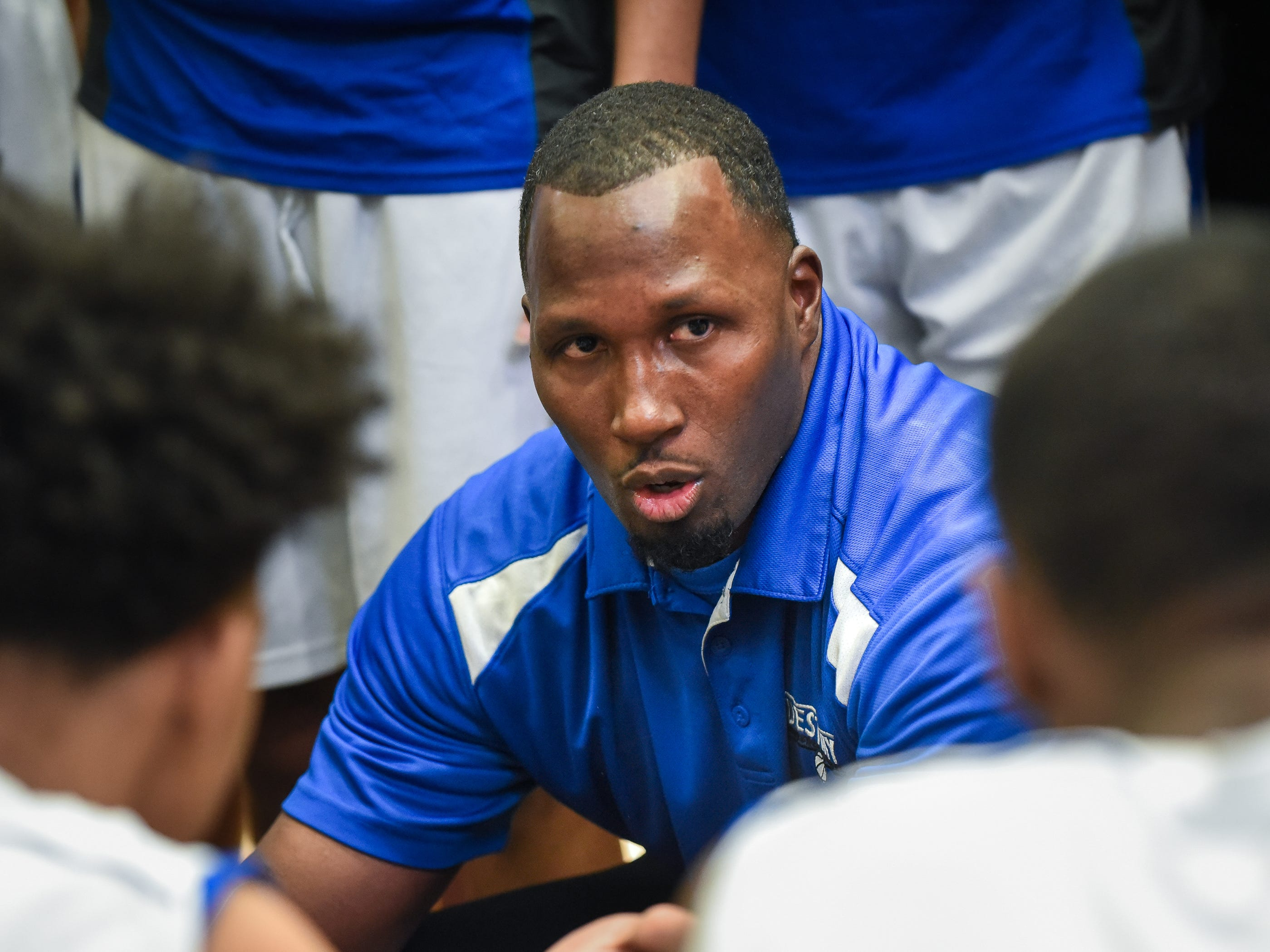 Destiny coach Billy Williams addresses his team during a timeout against Brown Deer in the Fresh Coast Classic basketball showcase Saturday, November 24, 2018, at UW-Milwaukee's Klotche Center.