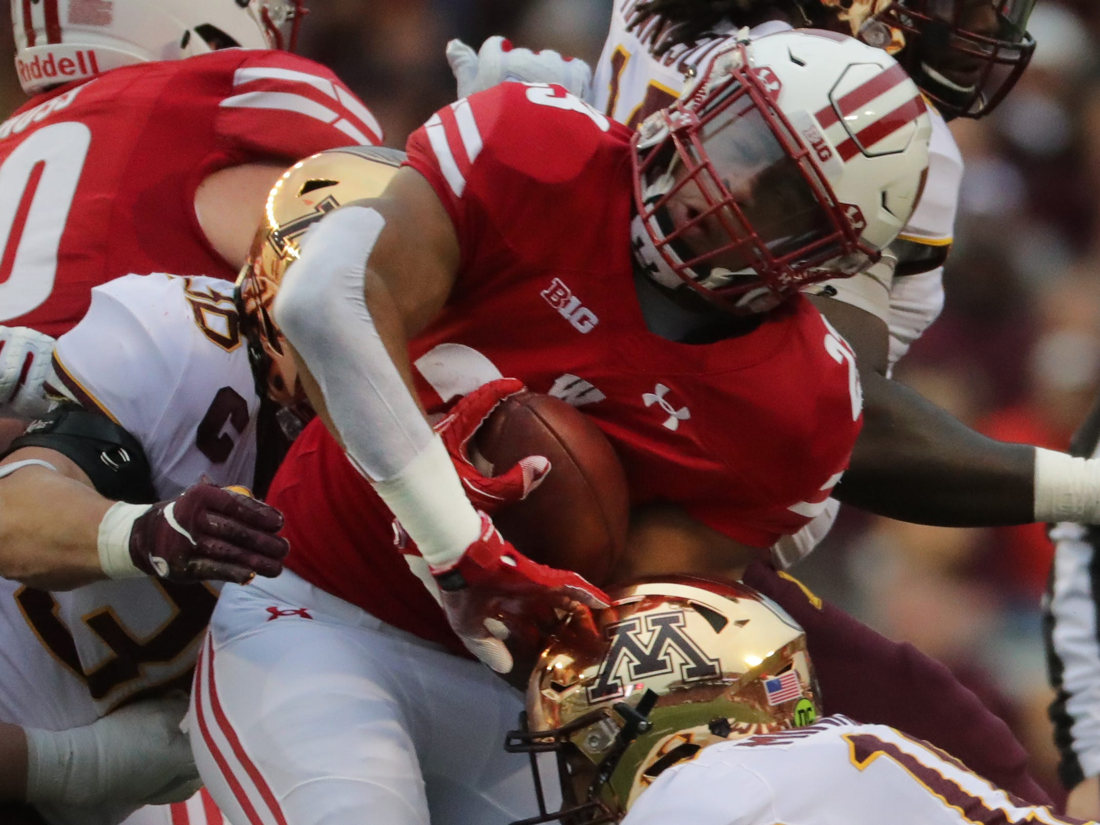 Wisconsin running back Jonathan Taylor  is stuffed at the line of scrimmage by Minnesota's defense during the first quarter Saturday.