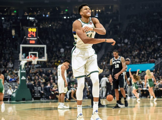 Bucks forward Giannis Antetokounmpo fires up the crowd at Fiserv Forum as his team took down the Spurs.