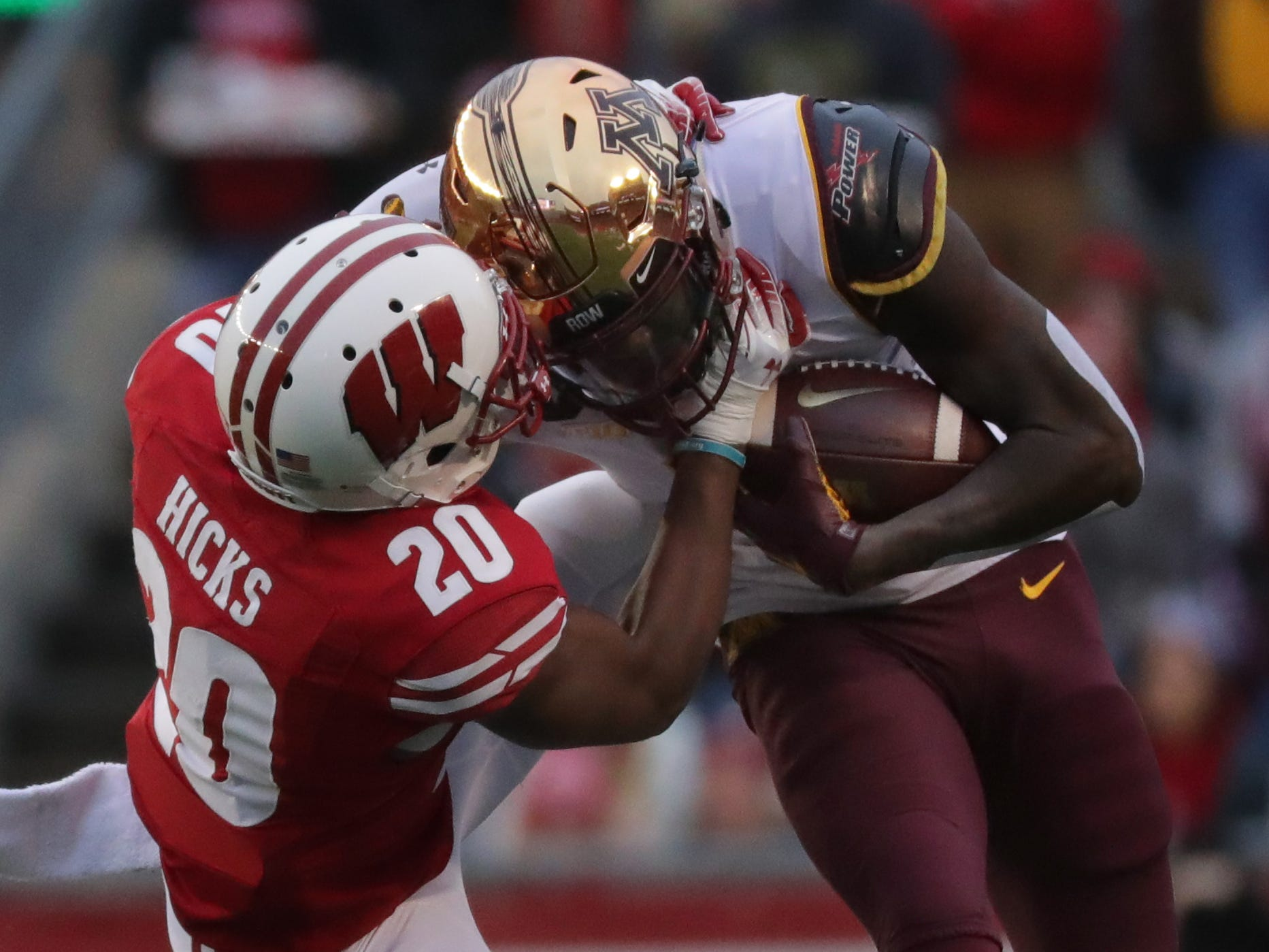 Wisconsin cornerback Faion Hicks brings down Minnesota wide receiver Tyler Johnson at the end of a 23-yard reception during the first quarter Saturday.