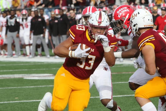 Senior Austin Vaughn (33) is at the top of the current depth chart among a crowded group of running backs. Though the coaching staff is adamant it's too soon to tell who will start against Grambling State.