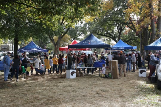 """Since Malone Stadium opened in 1978, the Grove became the epicenter for decades of concerts, chili cookoffs, """"Hawk Walks"""" and postgame activities."""