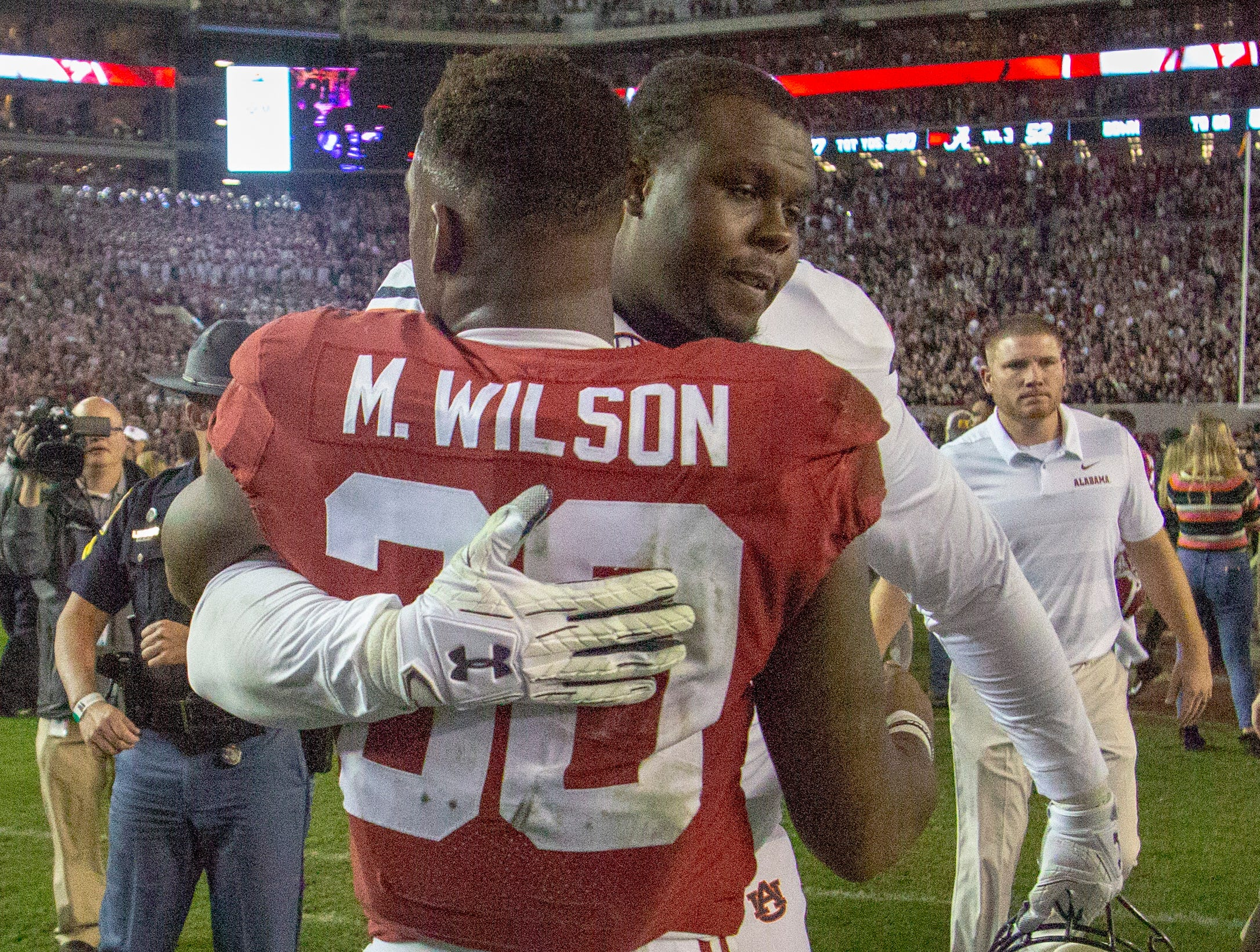 Alabama's Mack Wilson, and Montgomery Native, hugs Auburn's Alec Jackson after the game.
