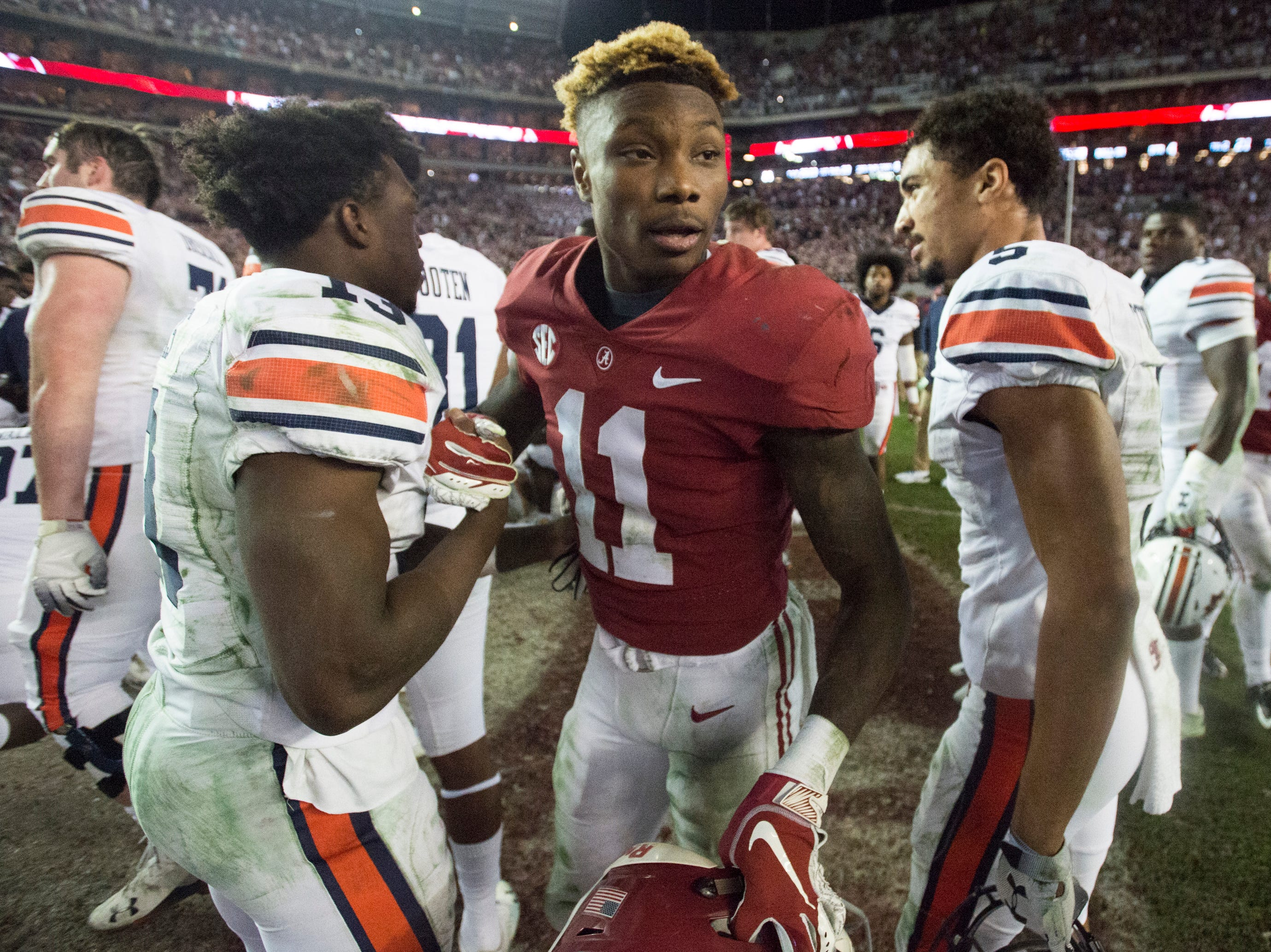 Alabama wide receiver Henry Ruggs, III, (11) shakes hands with Auburn players after the Iron Bowl at Bryant-Denny Stadium in Tuscaloosa, Ala., on Saturday, Nov. 24, 2018. Alabama defeated Auburn 52-21.