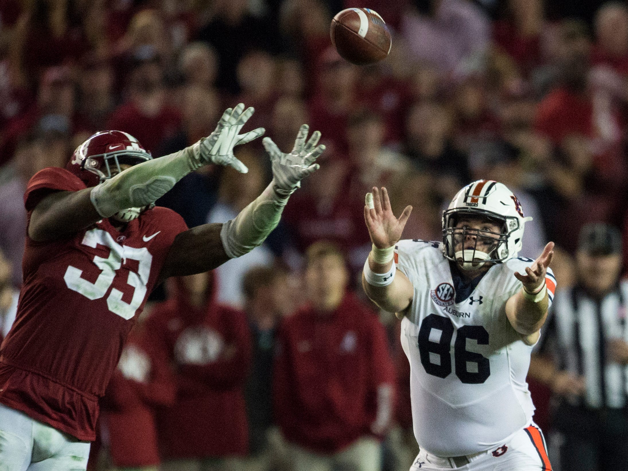 Alabama linebacker Anfernee Jennings (33) intercepts a pass intended for Auburn tight end Tucker Brown (86) during the Iron Bowl at Bryant-Denny Stadium in Tuscaloosa, Ala., on Saturday, Nov. 24, 2018. Alabama defeated Auburn 52-21.
