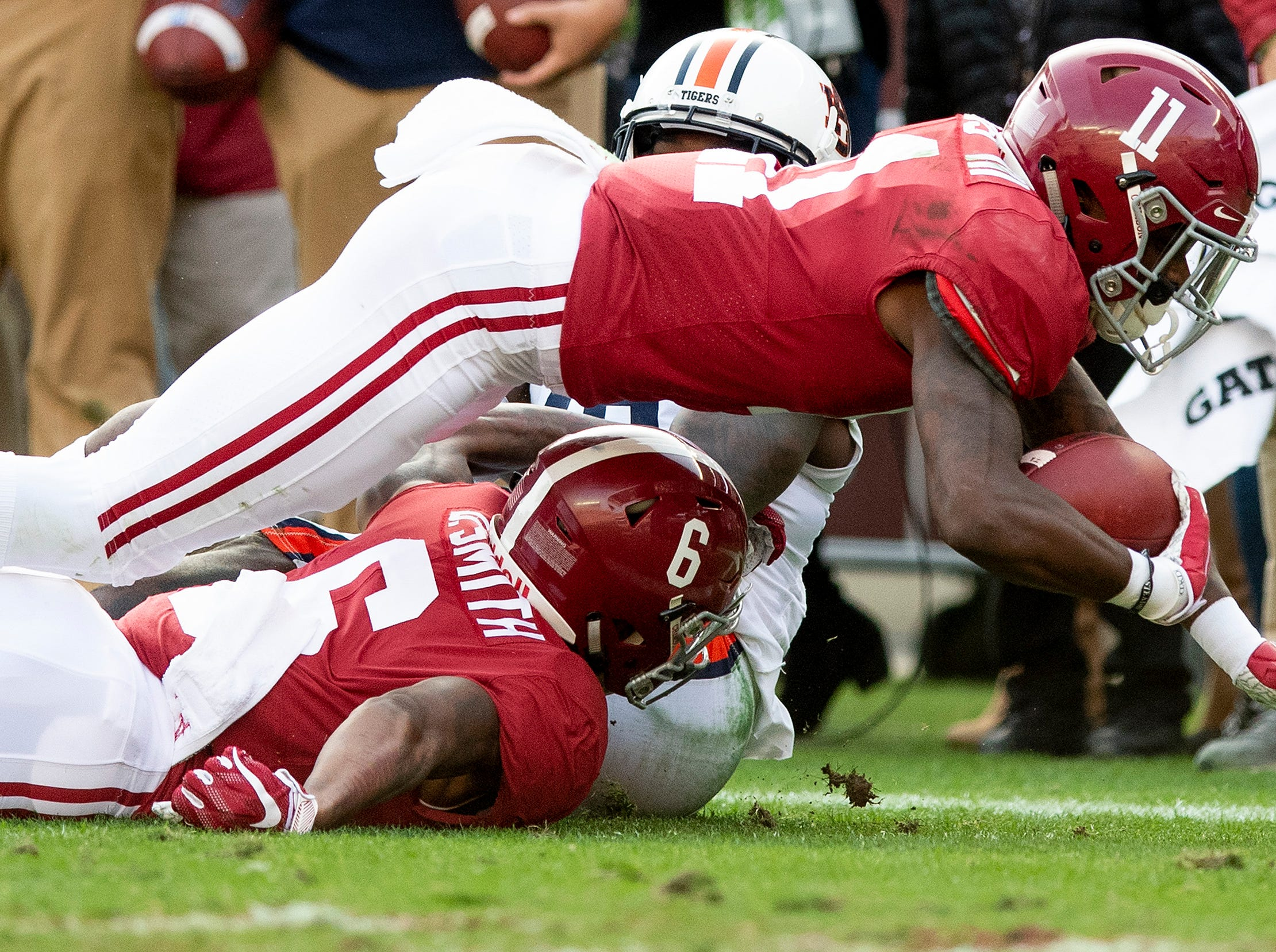 Alabama wide receiver Henry Ruggs, III, (11) dives for yardage against Auburn in first half action during the Iron Bowl at Bryant-Denny Stadium in Tuscaloosa, Ala., on Saturday November 24, 2018.