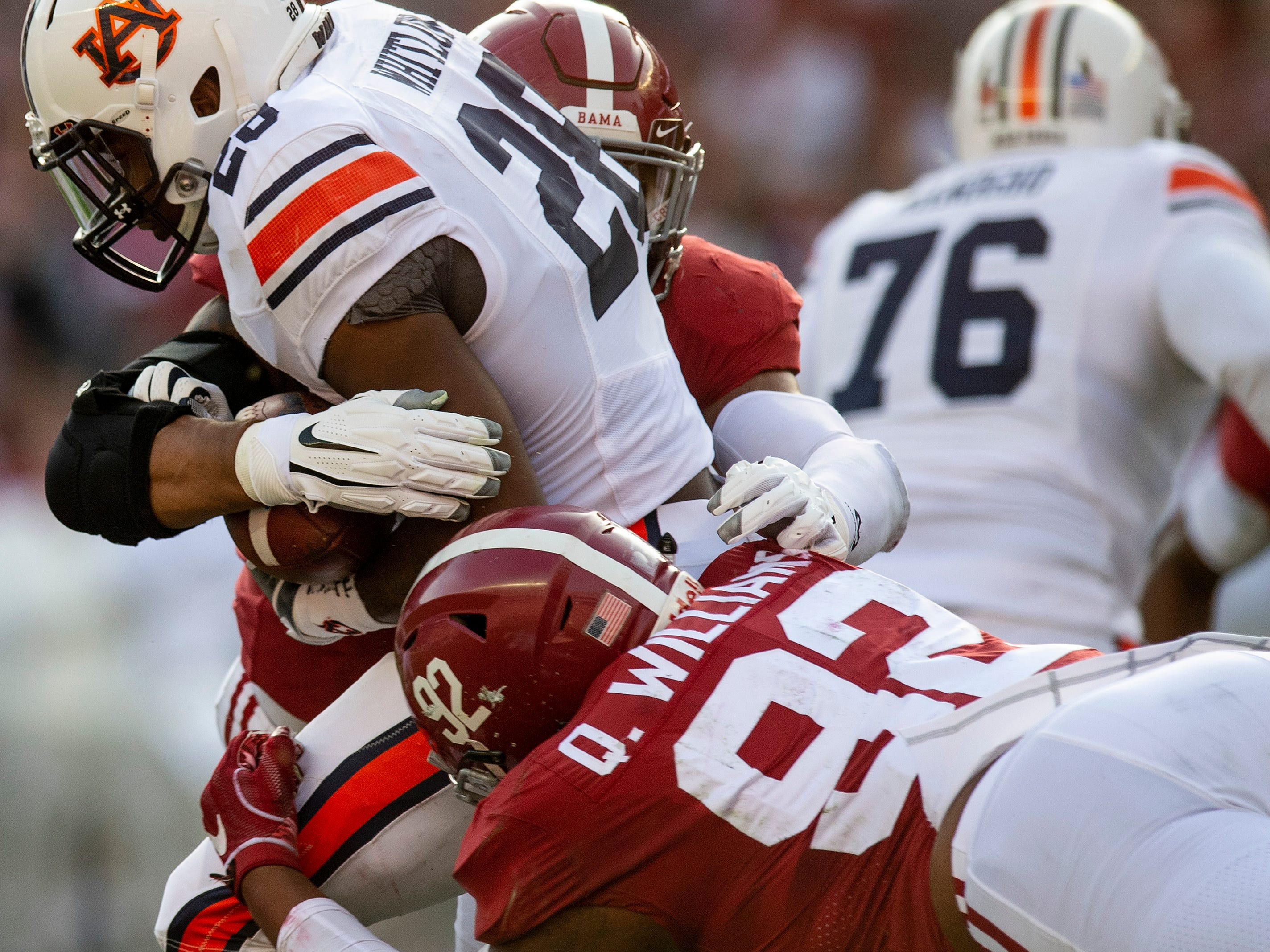 Alabama linebacker Christian Miller (47) and defensive lineman Quinnen Williams (92) wrap up Auburn running back JaTarvious Whitlow (28) in first half action during the Iron Bowl at Bryant-Denny Stadium in Tuscaloosa, Ala., on Saturday November 24, 2018.