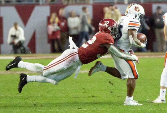 Alabama's Dylan Moses goes parallel for a tackle in the fourth quarter.
