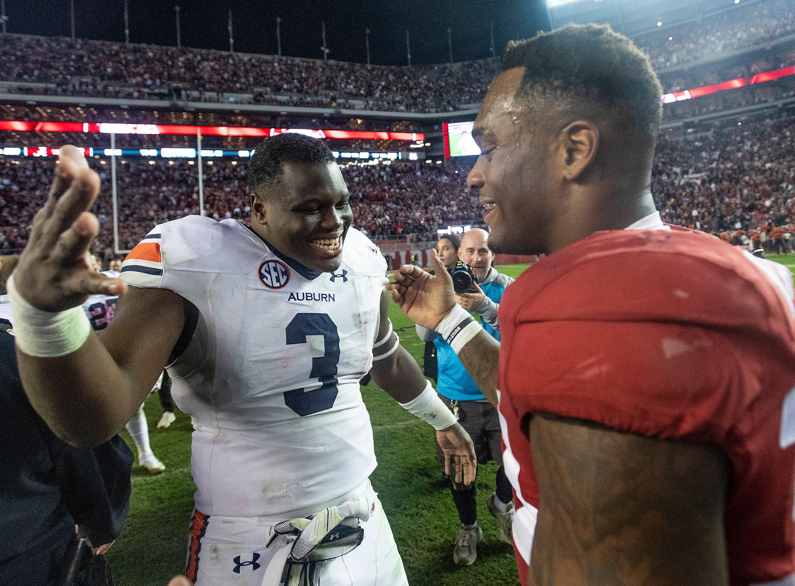 Alabama linebacker Mack Wilson (30) and Auburn defensive lineman Marlon Davidson (3) greet each other after the Iron Bowl at Bryant-Denny Stadium in Tuscaloosa, Ala., on Saturday November 24, 2018.