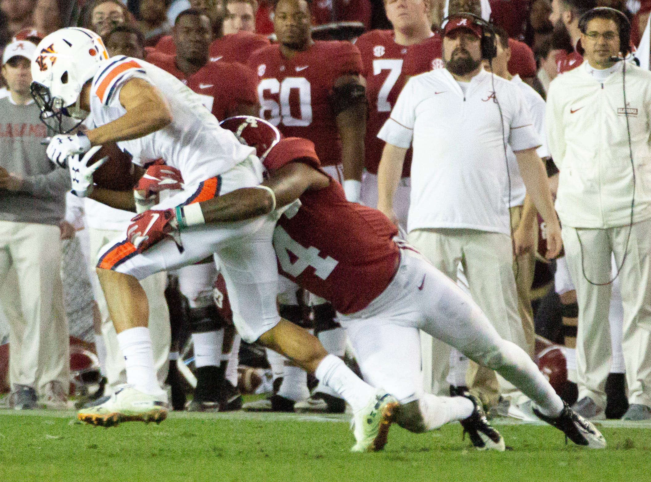 Auburn's Anthony Schwartz is brought down by Alabama's Saivion Smith during the third quarter.
