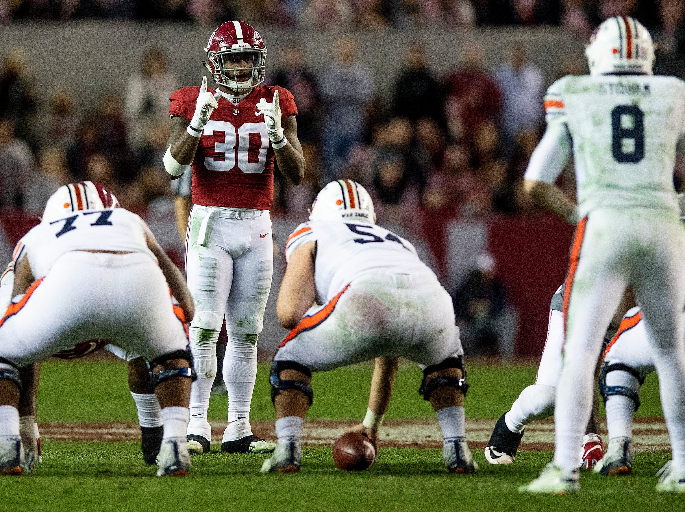 Alabama linebacker Mack Wilson (30) directs the defense against Auburn in second half action during the Iron Bowl at Bryant-Denny Stadium in Tuscaloosa, Ala., on Saturday November 24, 2018.
