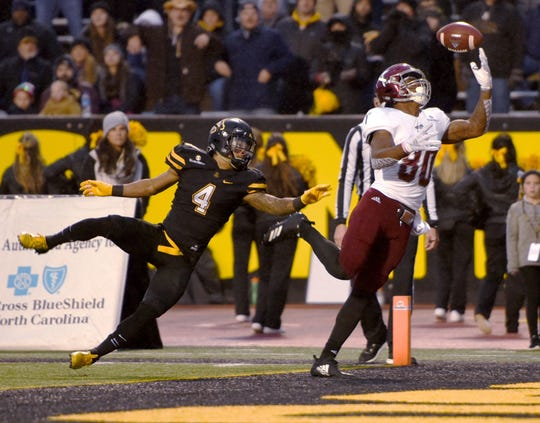 Troy wide receiver Deondre Douglas pulls down a reception for a touchdown over Appalachian State defensive back Clifton Duck during an NCAA football game, Saturday, Nov. 24, 2018 at Kidd Brewer Stadium in Boone, N.C. (Walt Unks/The Winston-Salem Journal via AP)