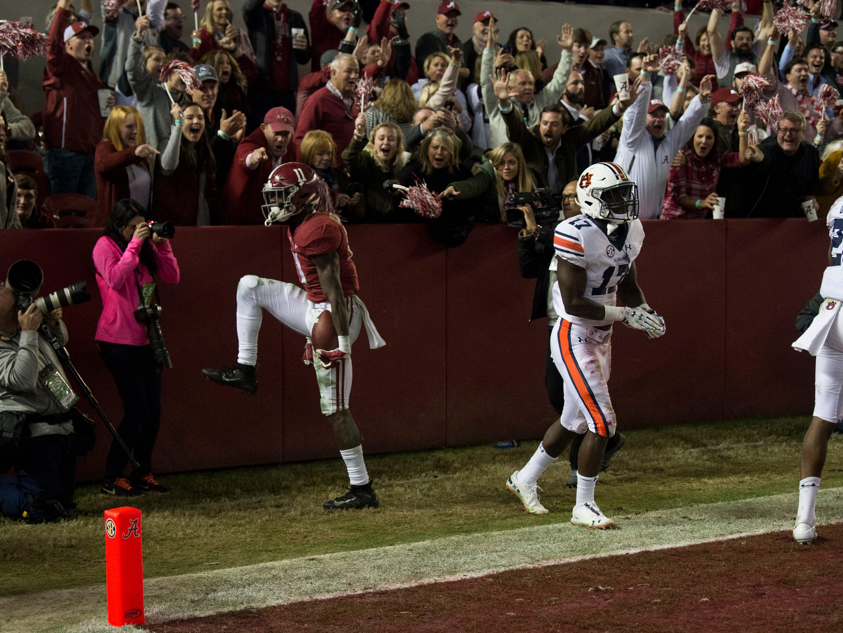 Alabama wide receiver Henry Ruggs, III, (11) reacts after catching a touchdown during the Iron Bowl at Bryant-Denny Stadium in Tuscaloosa, Ala., on Saturday, Nov. 24, 2018. Alabama defeated Auburn 52-21.