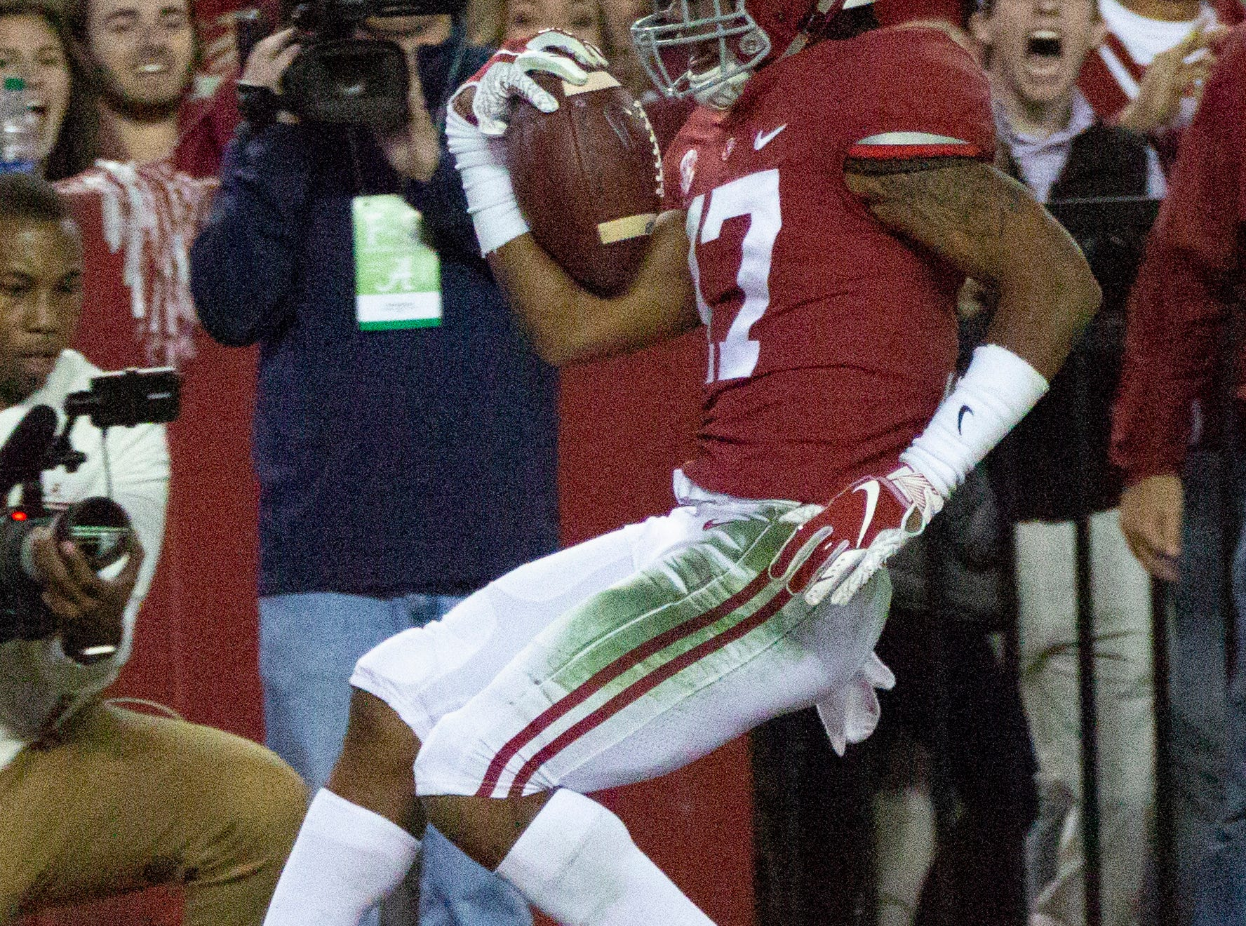 Alabama's Jaylen Waddle poses after scoring a touchdown for the Tide in the fourth quarter.