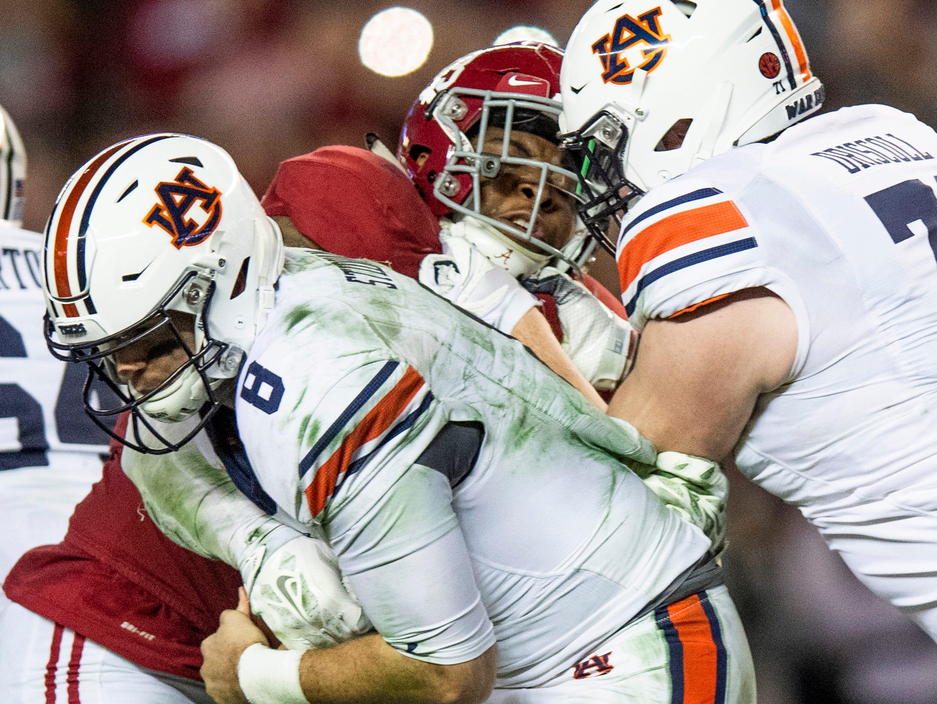 Alabama linebacker Anfernee Jennings (33) sacks Auburn quarterback Jarrett Stidham (8) in second half action during the Iron Bowl at Bryant-Denny Stadium in Tuscaloosa, Ala., on Saturday November 24, 2018.