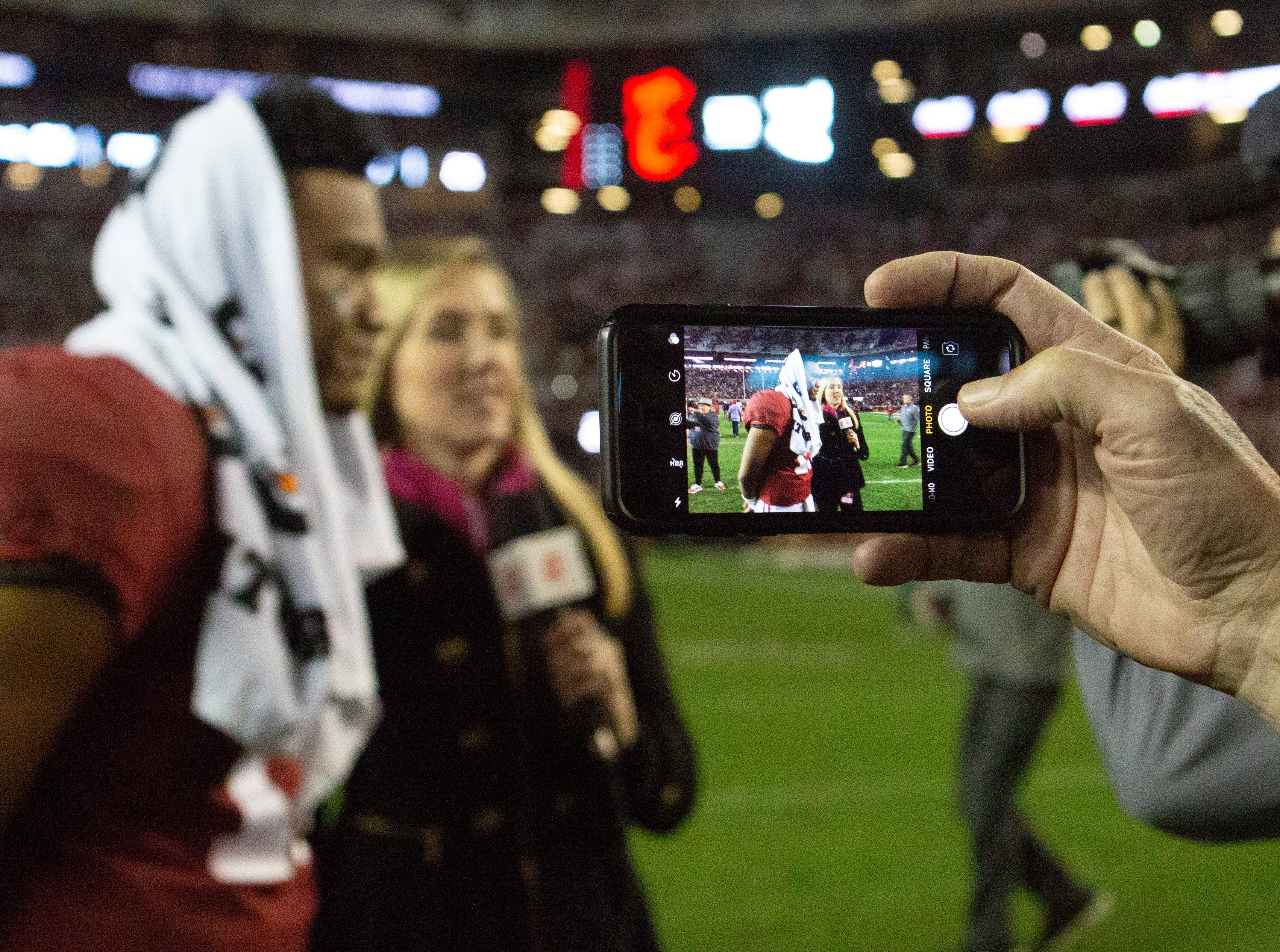 Alabama's Tua Tagovailoa does an interview after the Crimson Tide defeated the Auburn Tigers in the Iron Bowl.