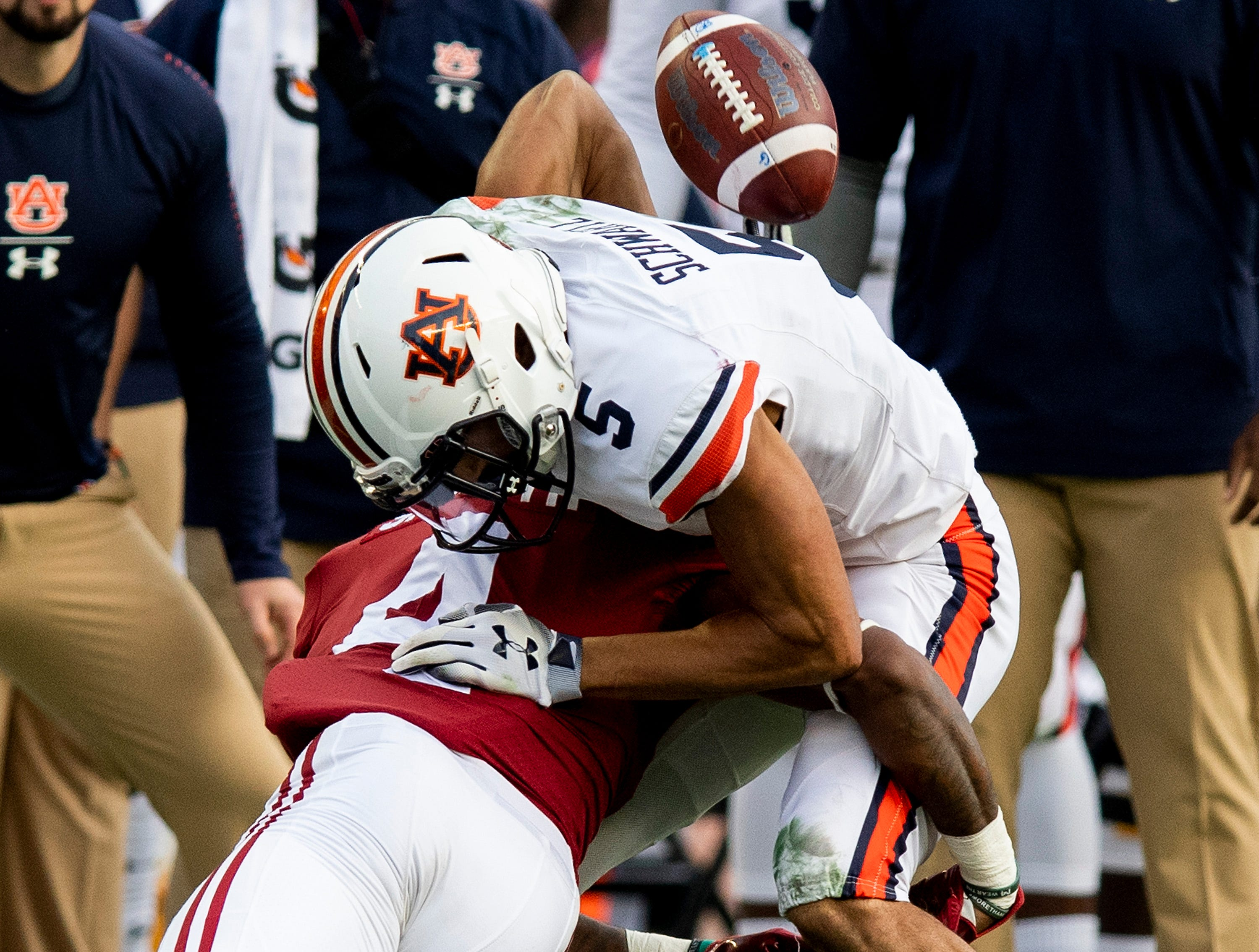 The ball pops out of bounds as Alabama defensive back Saivion Smith (4) hits Auburn wide receiver Anthony Schwartz (5) in first half action during the Iron Bowl at Bryant-Denny Stadium in Tuscaloosa, Ala., on Saturday November 24, 2018.