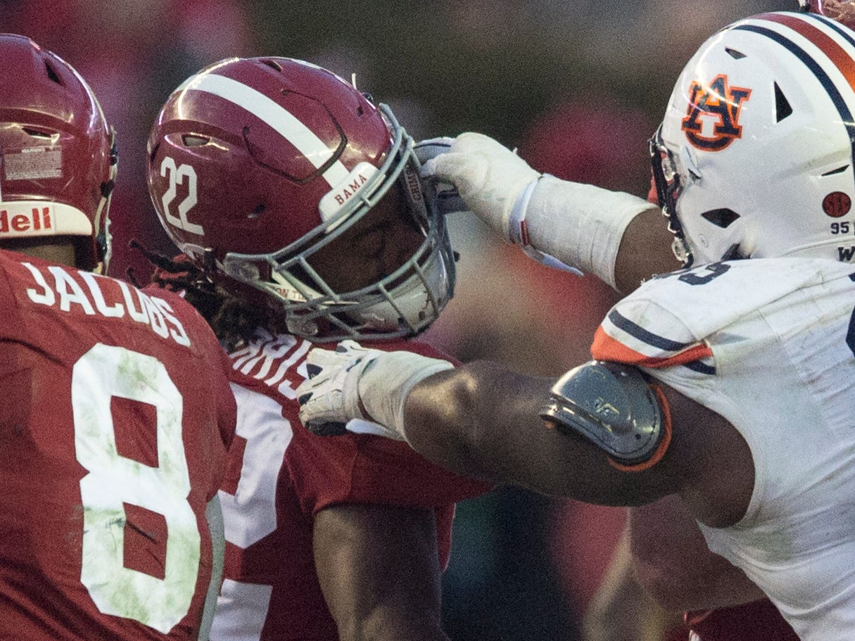 Auburn defensive lineman Dontavius Russell (95) is called for a face mask penalty as he attempts to tackle Alabama running back Najee Harris (22) during the Iron Bowl at Bryant-Denny Stadium in Tuscaloosa, Ala., on Saturday, Nov. 24, 2018. Alabama defeated Auburn 52-21.