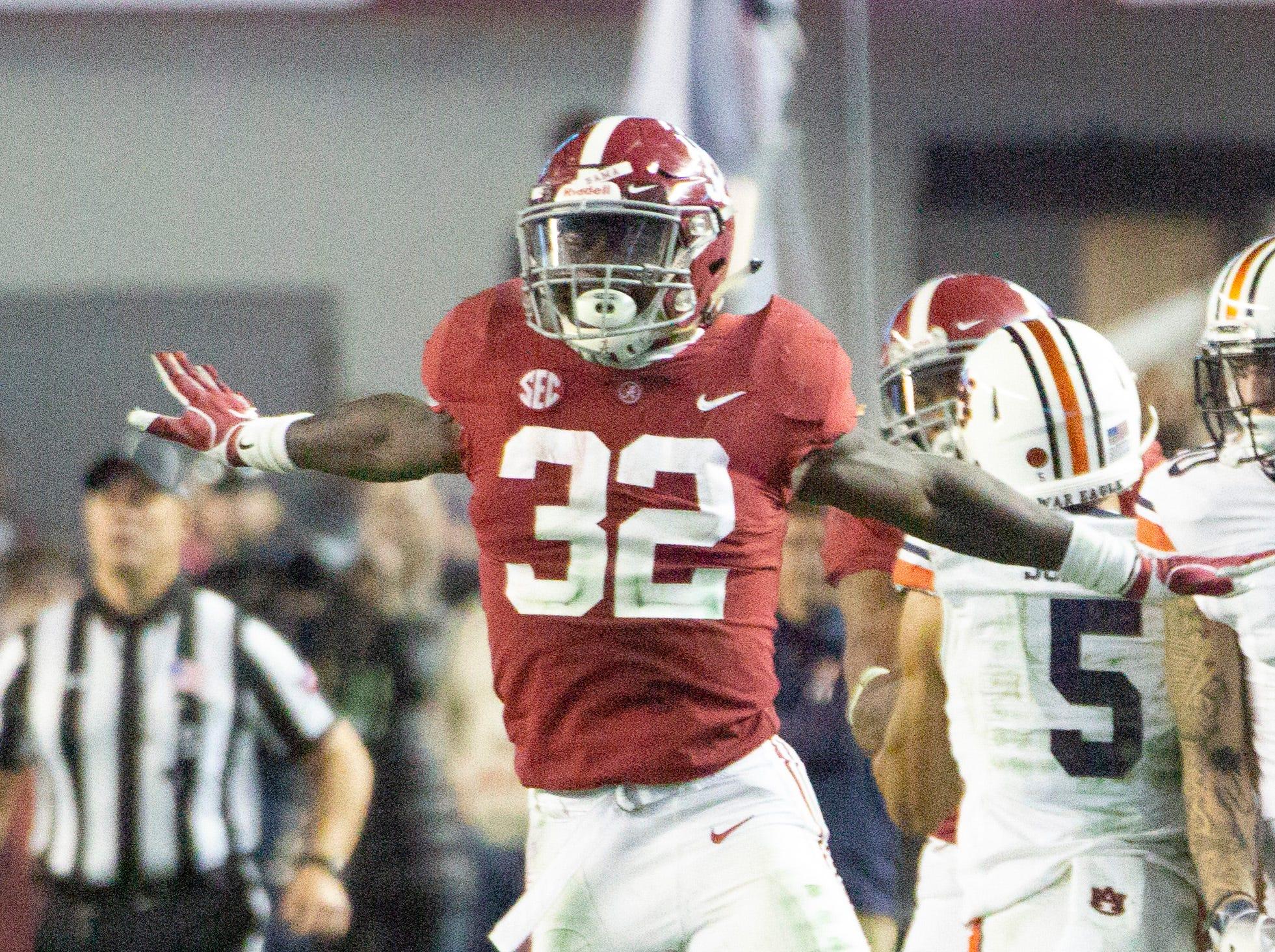 Alabama's Dylan Moses celebrates his tackle.