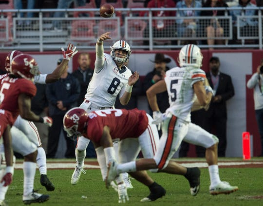 Auburn quarterback Jarrett Stidham (8) throws the ball to Auburn wide receiver Anthony Schwartz (5) during the Iron Bowl at Bryant-Denny Stadium in Tuscaloosa, Ala., on Saturday, Nov. 24, 2018. Alabama defeated Auburn 52-21.