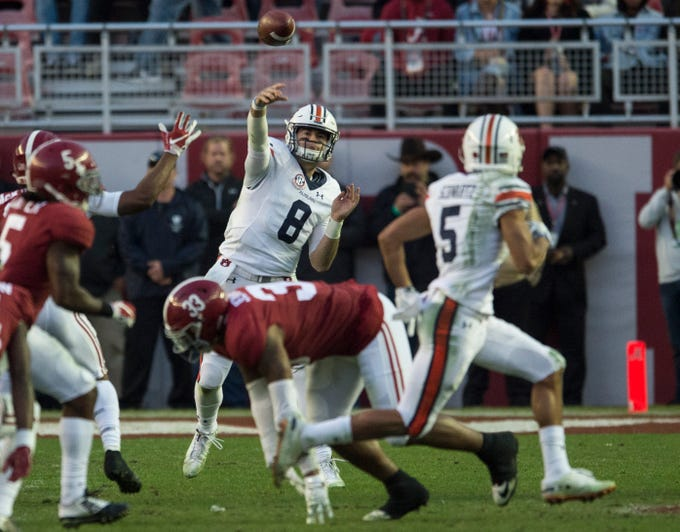 Auburn quarterback Jarrett Stidham (8) throws the ball to Auburn wide receiver Anthony Schwartz (5) during the Iron Bowl at Bryant-Denny Stadium in Tuscaloosa, Ala., on Saturday, Nov. 24, 2018. Alabama defeated Auburn 52-21.