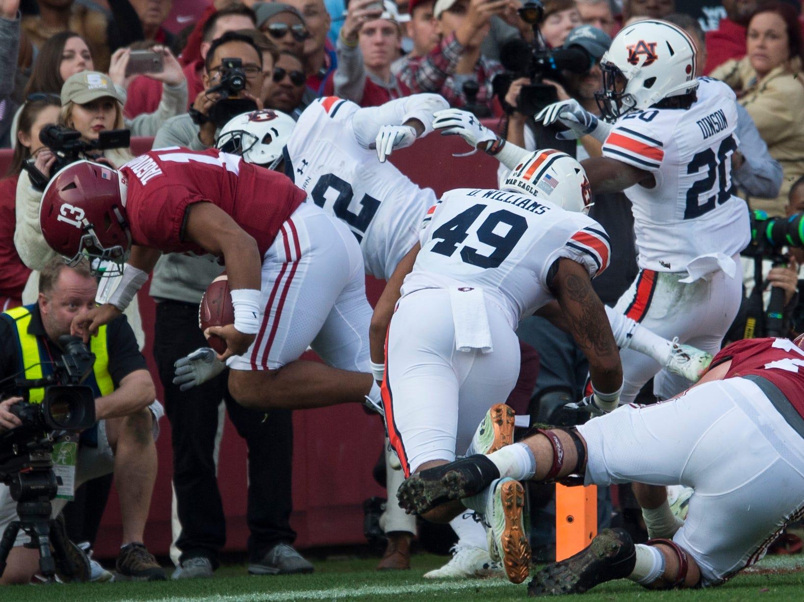 Alabama quarterback Tua Tagovailoa (13) runs into the end zone for a touchdown during the Iron Bowl at Bryant-Denny Stadium in Tuscaloosa, Ala., on Saturday, Nov. 24, 2018. Alabama leads Auburn 17-14 at halftime.