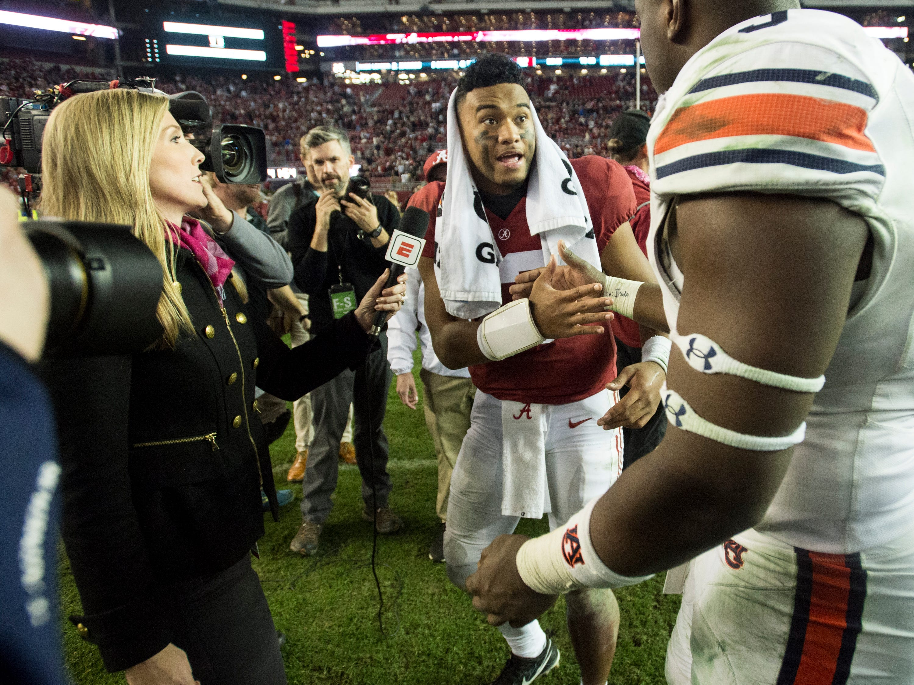 Alabama quarterback Tua Tagovailoa (13) shakes hands with Auburn defensive lineman Marlon Davidson (3) during the Iron Bowl at Bryant-Denny Stadium in Tuscaloosa, Ala., on Saturday, Nov. 24, 2018. Alabama defeated Auburn 52-21.