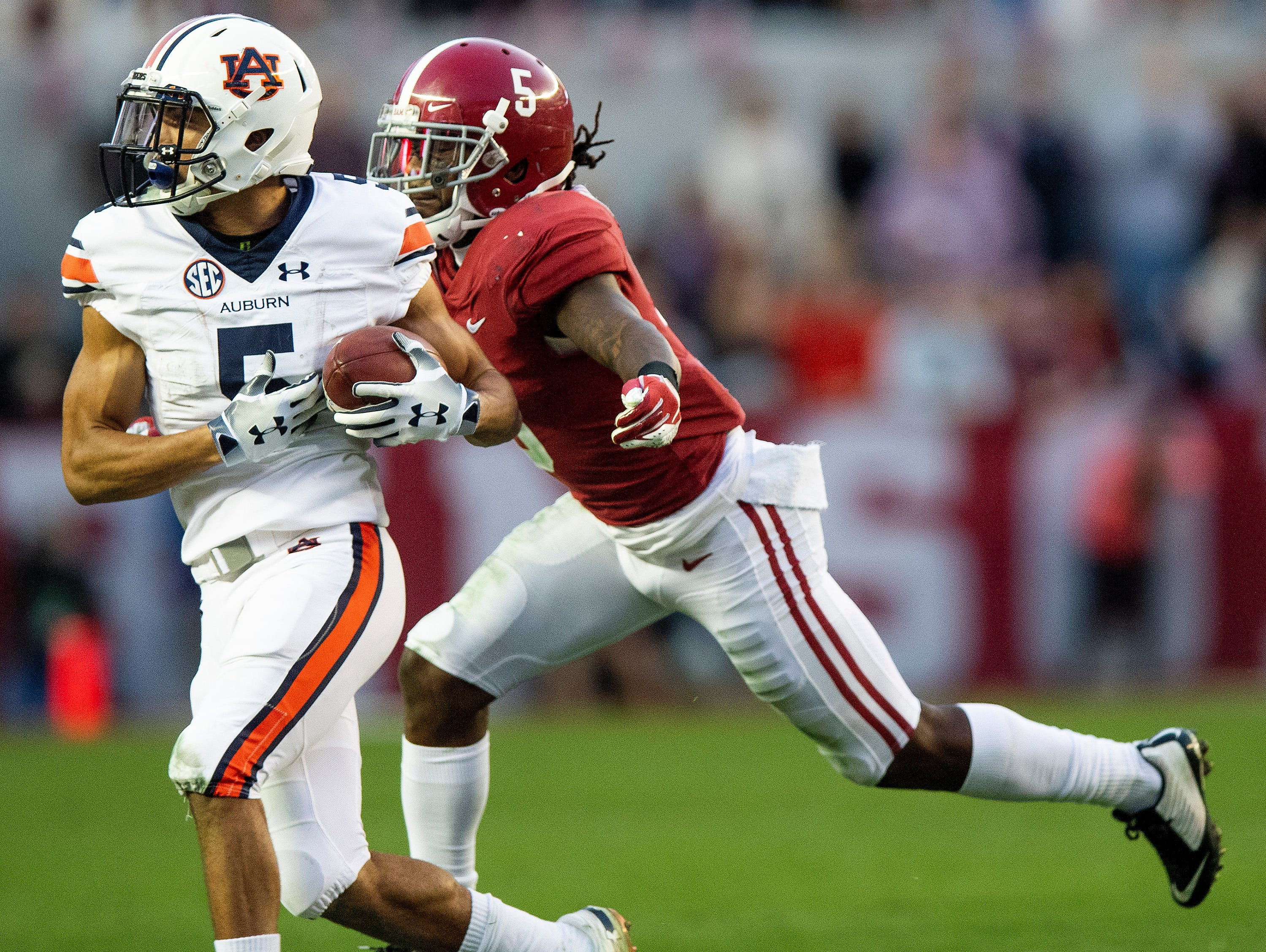 Alabama defensive back Shyheim Carter (5) stops Auburn wide receiver Anthony Schwartz (5) in second half action during the Iron Bowl at Bryant-Denny Stadium in Tuscaloosa, Ala., on Saturday November 24, 2018.