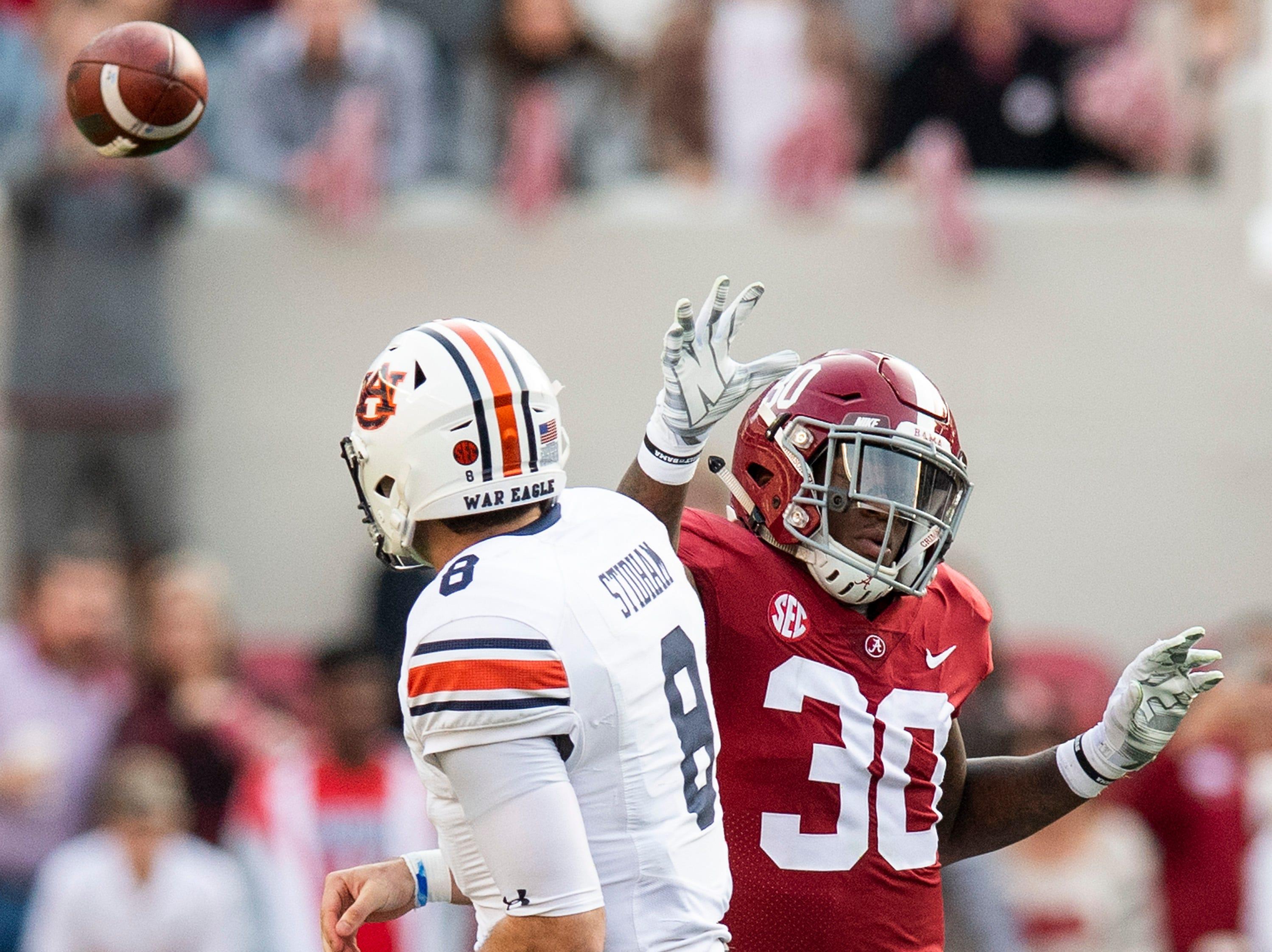 Alabama linebacker Mack Wilson (30) pressures Auburn quarterback Jarrett Stidham (8) in first half action during the Iron Bowl at Bryant-Denny Stadium in Tuscaloosa, Ala., on Saturday November 24, 2018.