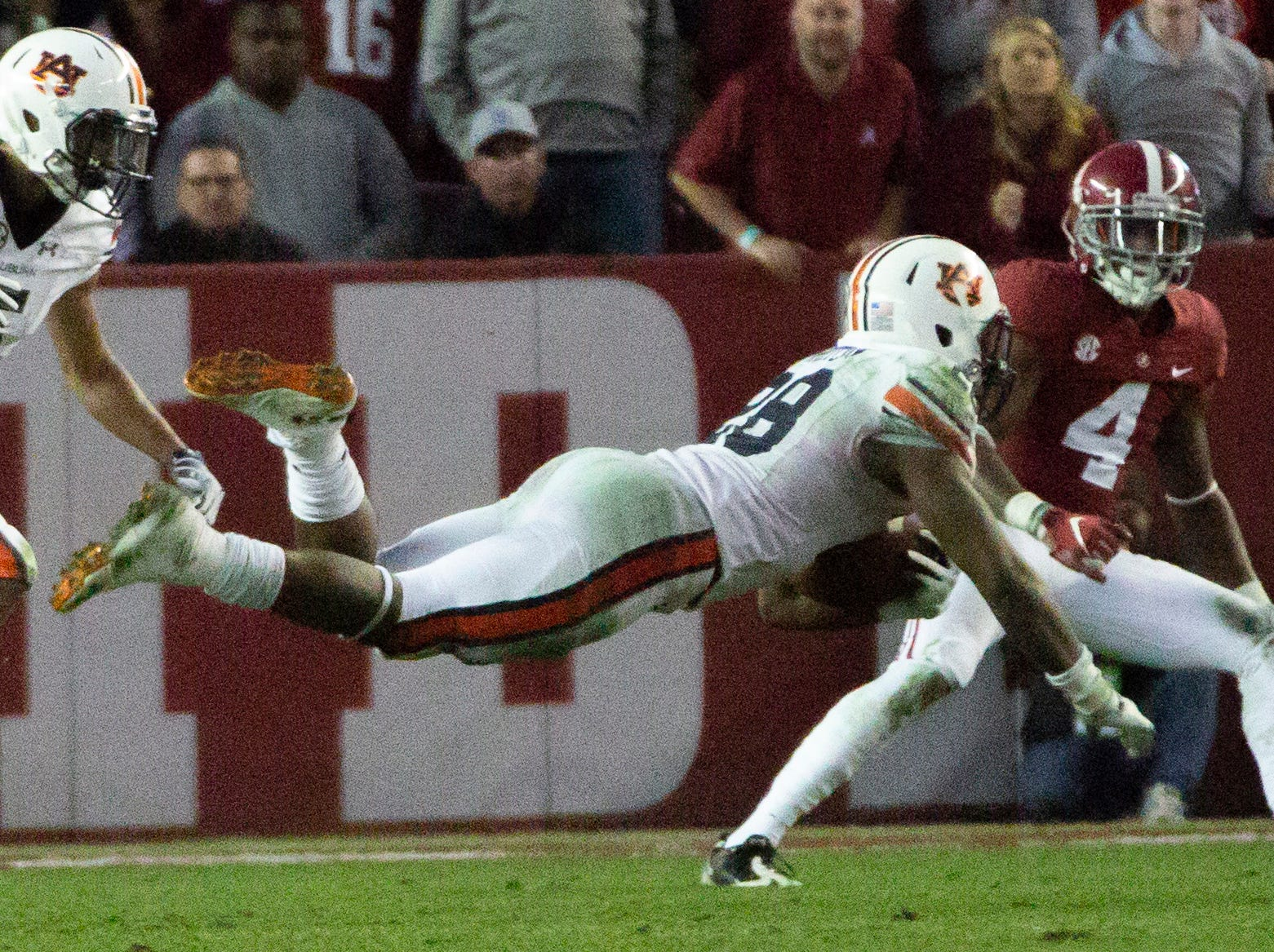 Auburn's JaTarvious Whitlow dives with the ball during the third quarter of the Iron Bowl.