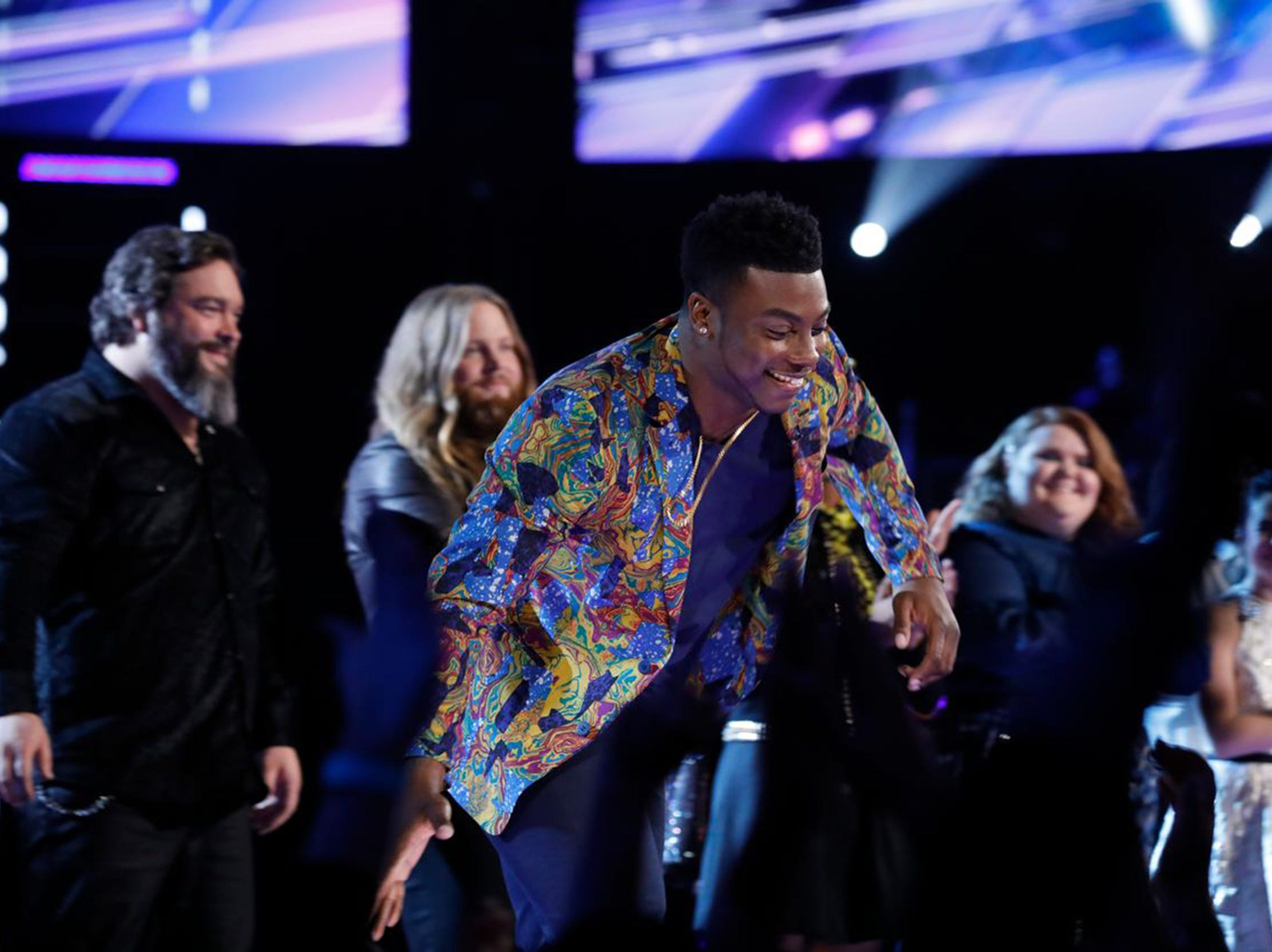 "Kirk Jay high-fives fans after being saved on Tuesday and moving into the top 11 on NBC's ""The Voice."" He will perform again live on Monday, Nov. 26."