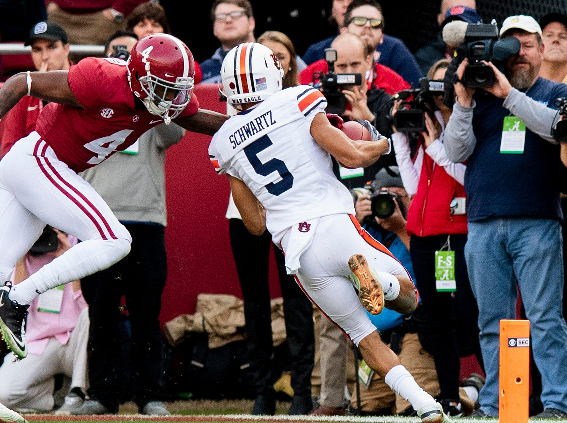 Auburn wide receiver Anthony Schwartz (5) scores a touchdown against Alabama defensive back Saivion Smith (4) in first half action during the Iron Bowl at Bryant-Denny Stadium in Tuscaloosa, Ala., on Saturday November 24, 2018.