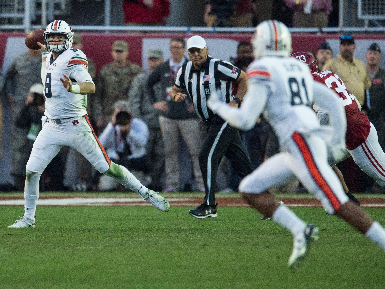 Auburn quarterback Jarrett Stidham (8) throws the ball in the direction of Auburn wide receiver Darius Slayton (81) during the Iron Bowl at Bryant-Denny Stadium in Tuscaloosa, Ala., on Saturday, Nov. 24, 2018. Alabama defeated Auburn 52-21.