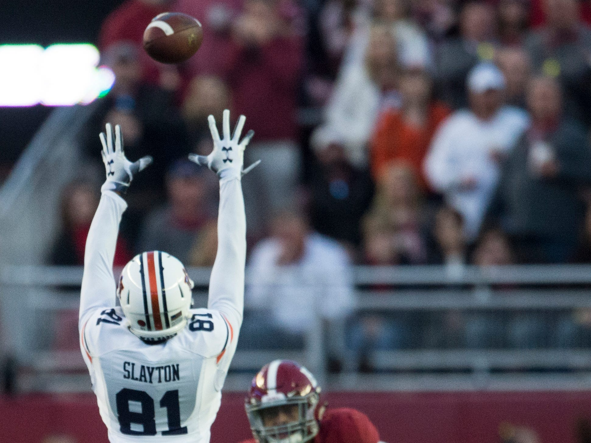Auburn wide receiver Darius Slayton (81) misses a high pass during the Iron Bowl at Bryant-Denny Stadium in Tuscaloosa, Ala., on Saturday, Nov. 24, 2018. Alabama defeated Auburn 52-21.
