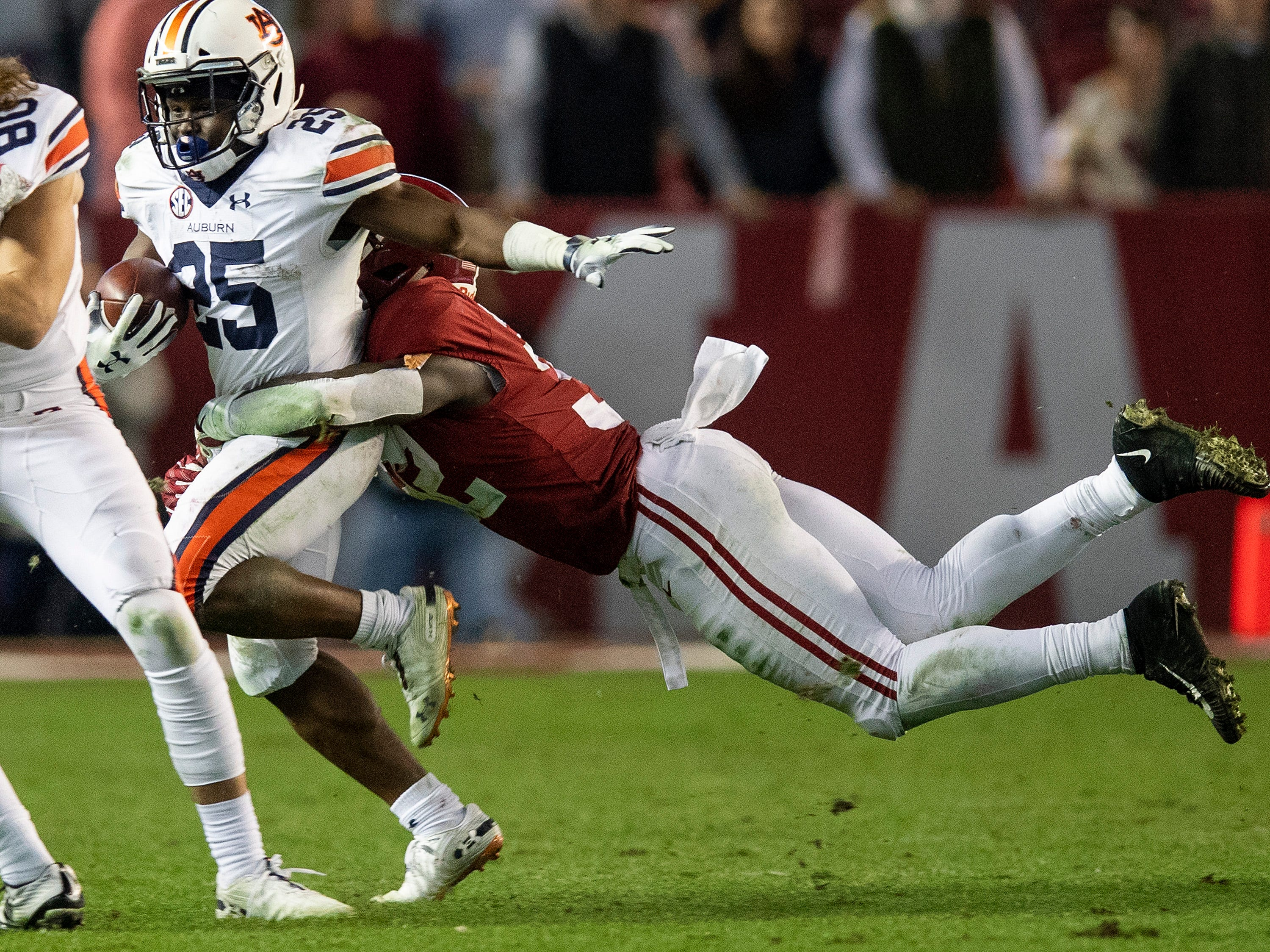 Alabama linebacker Dylan Moses (32) stops Auburn running back Shaun Shivers (25) in second half action during the Iron Bowl at Bryant-Denny Stadium in Tuscaloosa, Ala., on Saturday November 24, 2018.