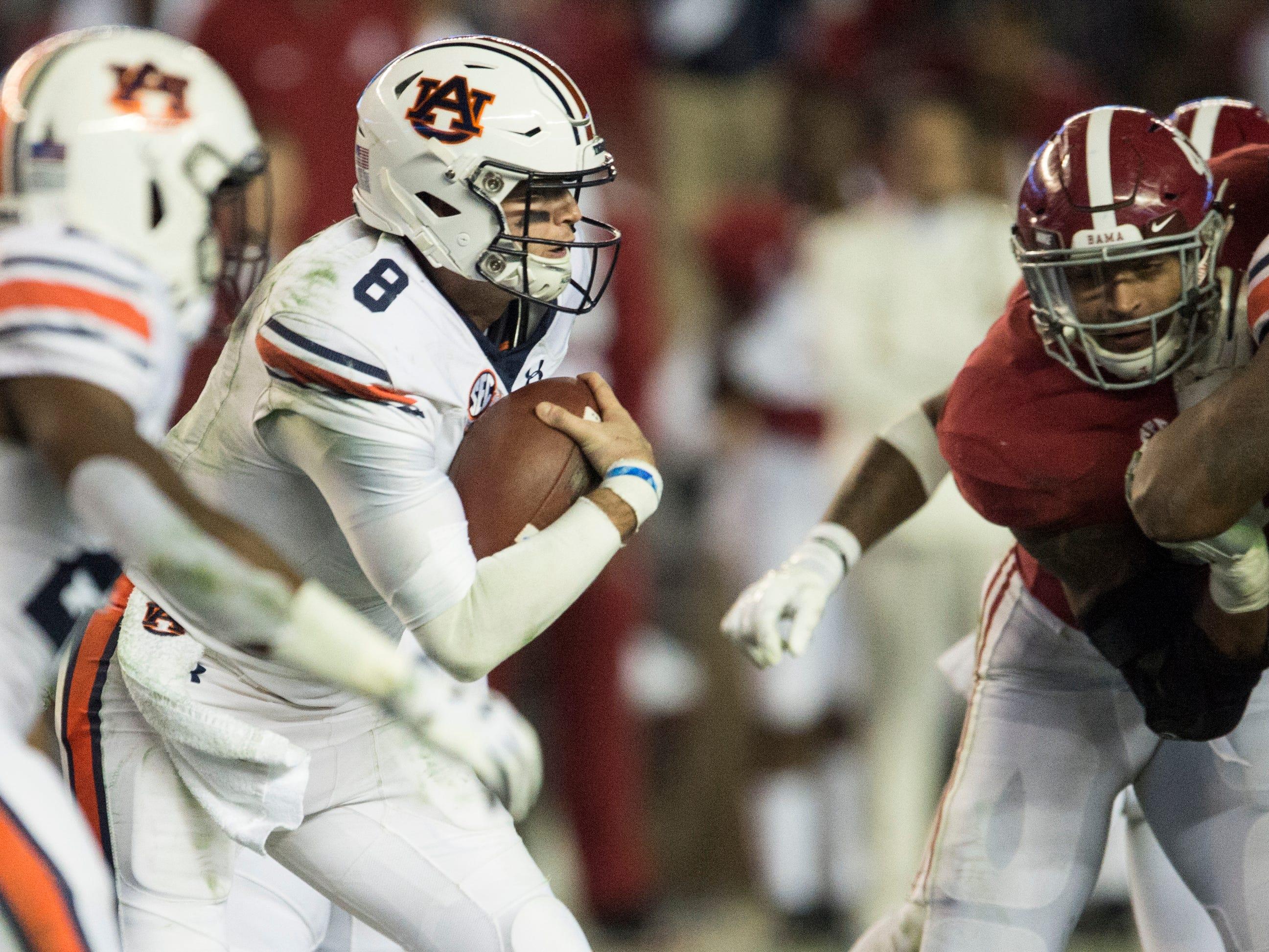 Auburn quarterback Jarrett Stidham (8) runs the ball against Alabama during the Iron Bowl at Bryant-Denny Stadium in Tuscaloosa, Ala., on Saturday, Nov. 24, 2018. Alabama defeated Auburn 52-21.