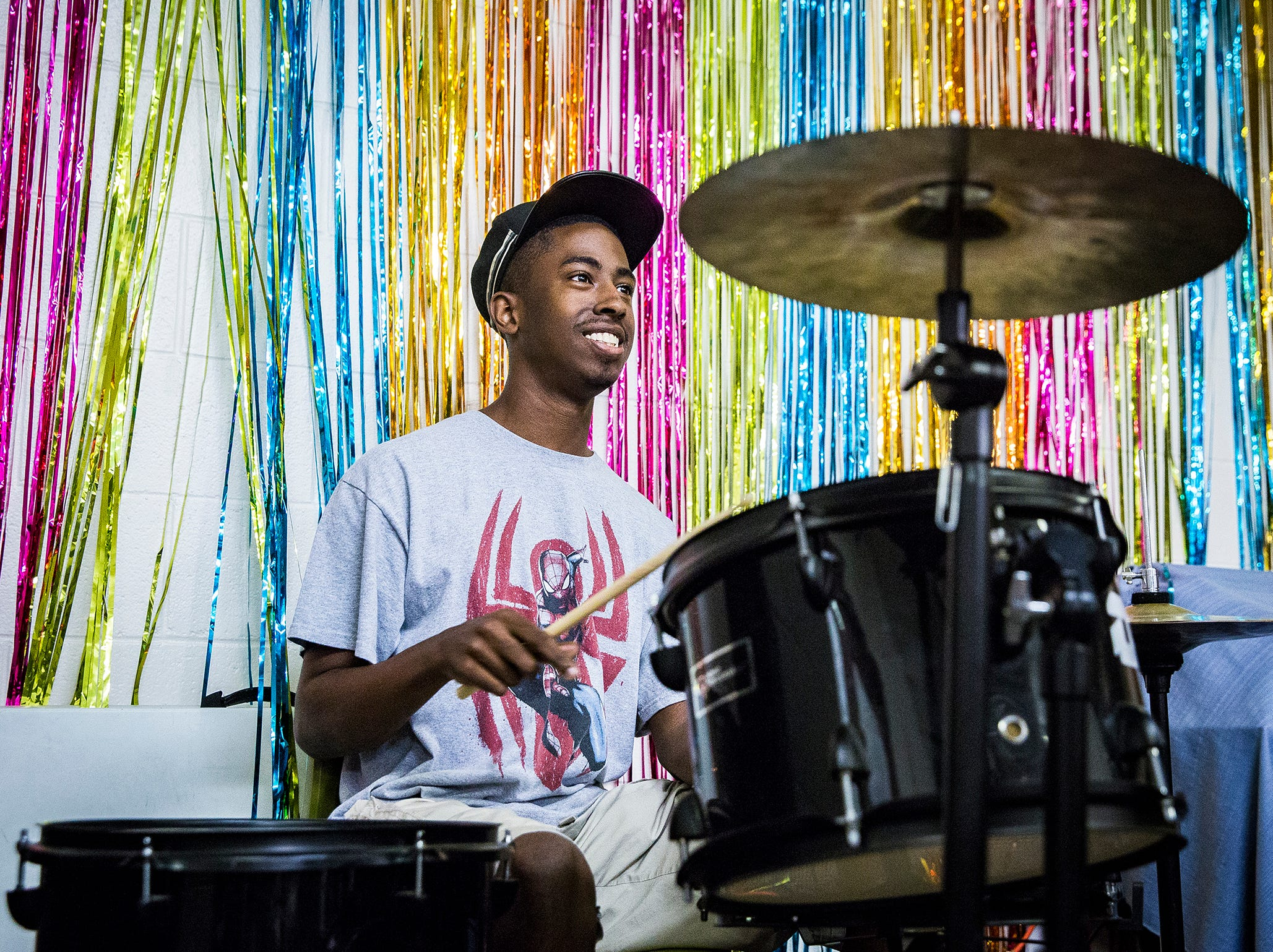 Kory Jones practices drumming at Hillcroft Services in Muncie. Jones settled on drums after experimenting with several different instruments.